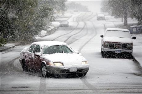 Motorists make their way during a snowstorm Friday in Rapid City, S.D.