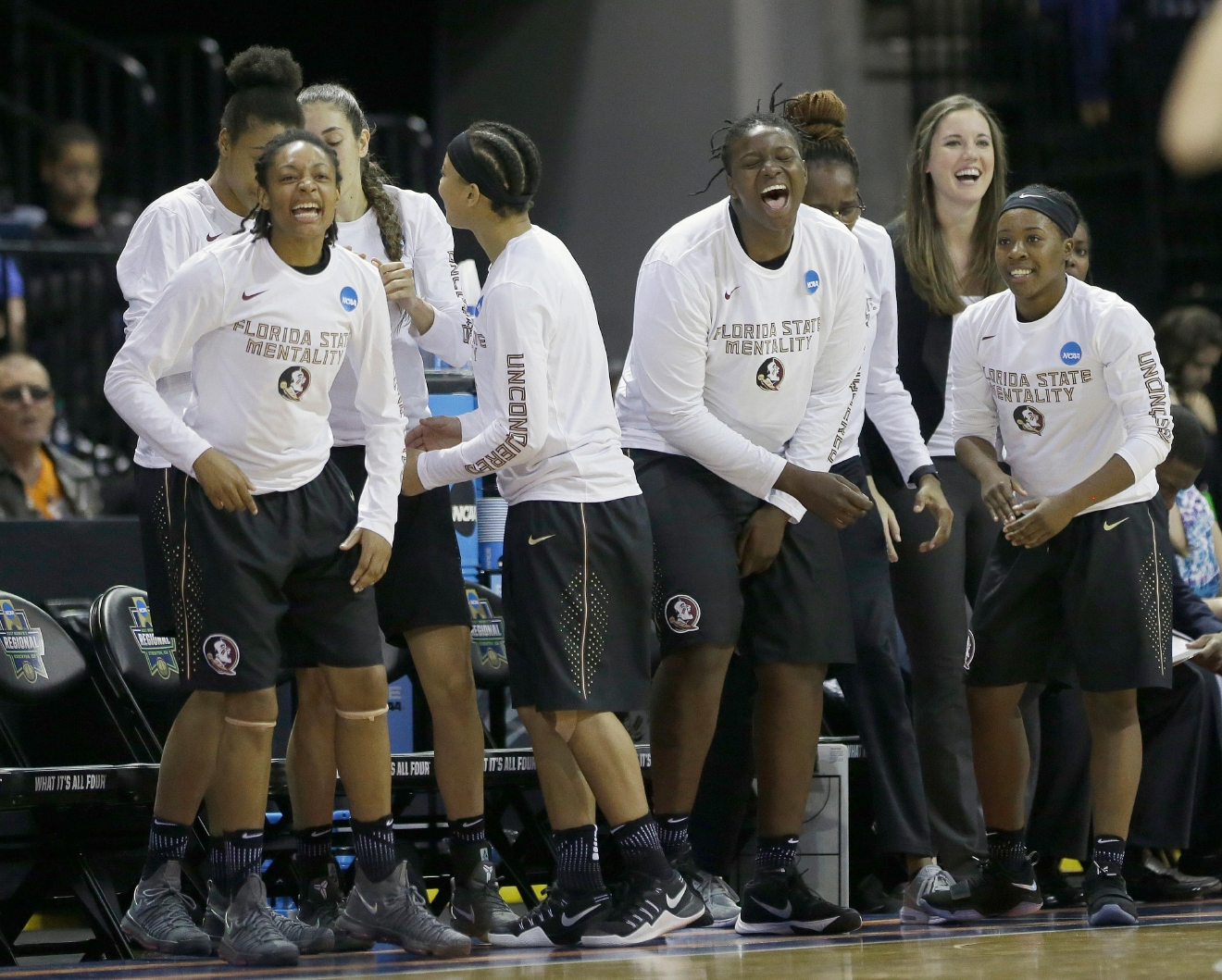 Florida State players celebrate in the closing moments of their 66-53 win over Oregon State in a regional semi-final round game of an NCAA college basketball tournament , Saturday, March 25, 2017, in Stockton, Calif. (AP Photo/Rich Pedroncelli)