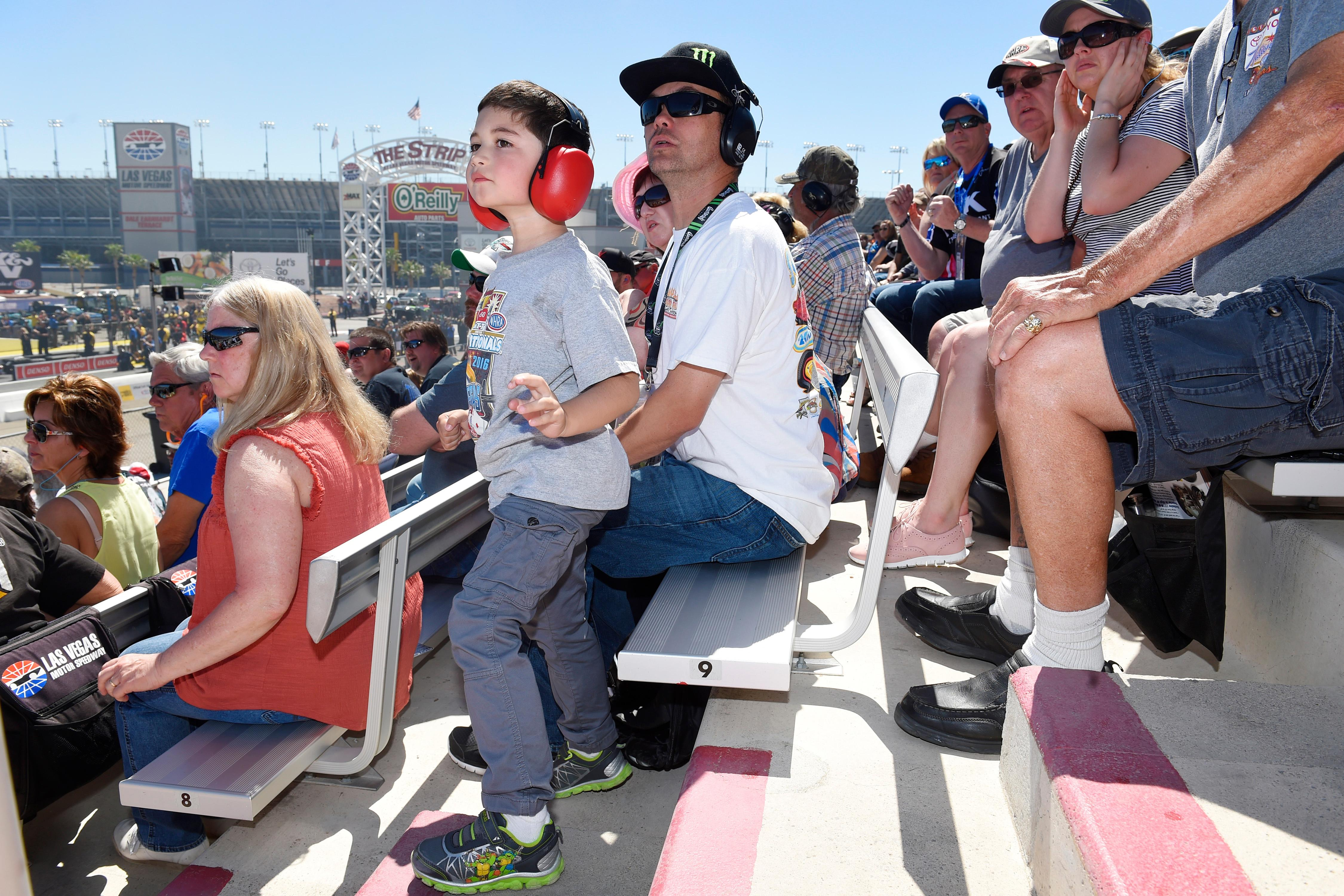 Kainoa Leong and his father Brian Leong watch the action during the 18th annual DENSO Spark Plugs NHRA Nationals Sunday, April 2, 2017, at The Strip at the Las Vegas Motor Speedway. (Sam Morris/Las Vegas News Bureau)