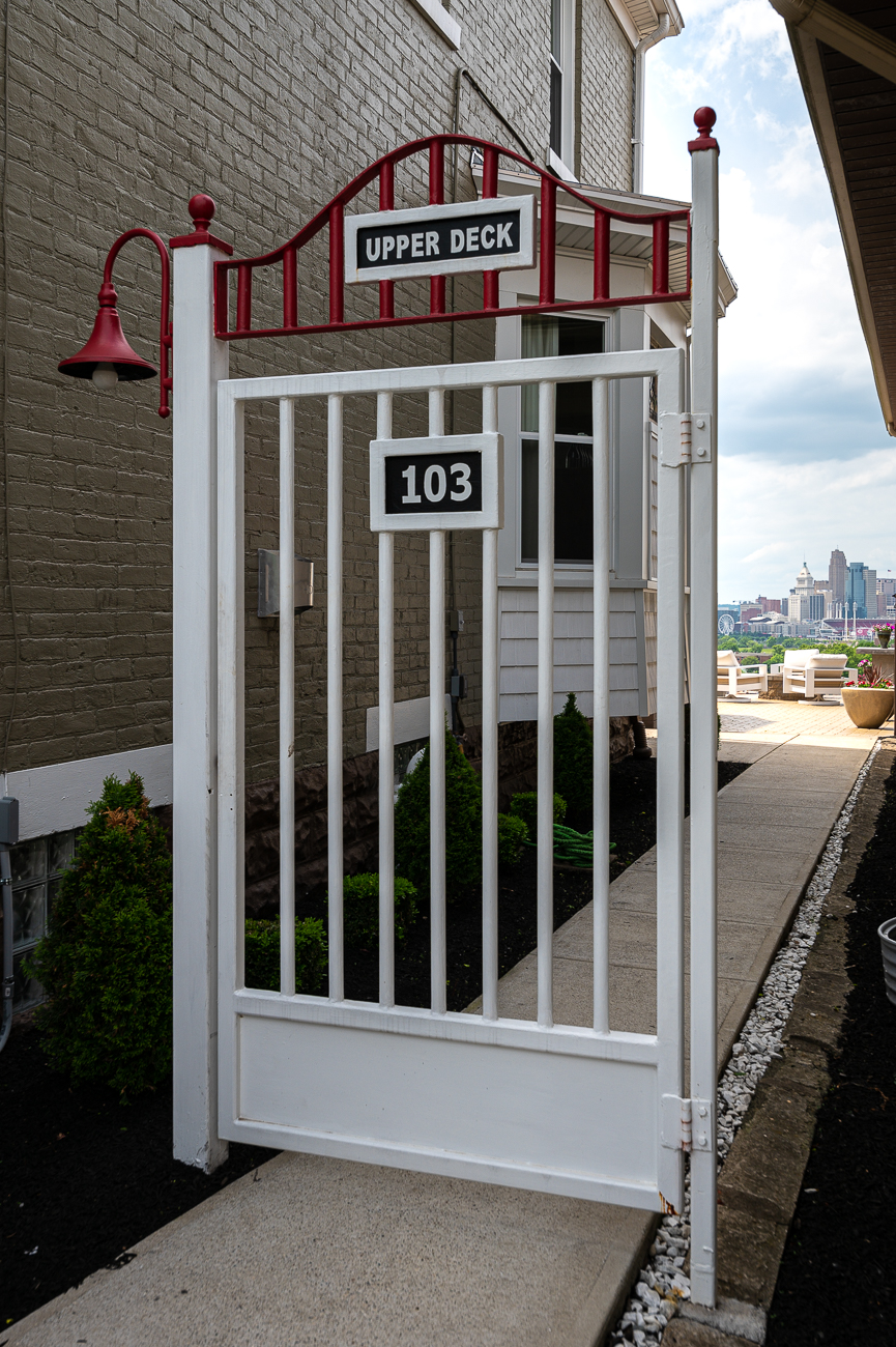 One of the coolest features of David's home is this original Crosley Field upper deck gate that blocks the way to the backyard. It weighs a ton and still lights up. / Image: Phil Armstrong, Cincinnati Refined // Published: 5.31.19