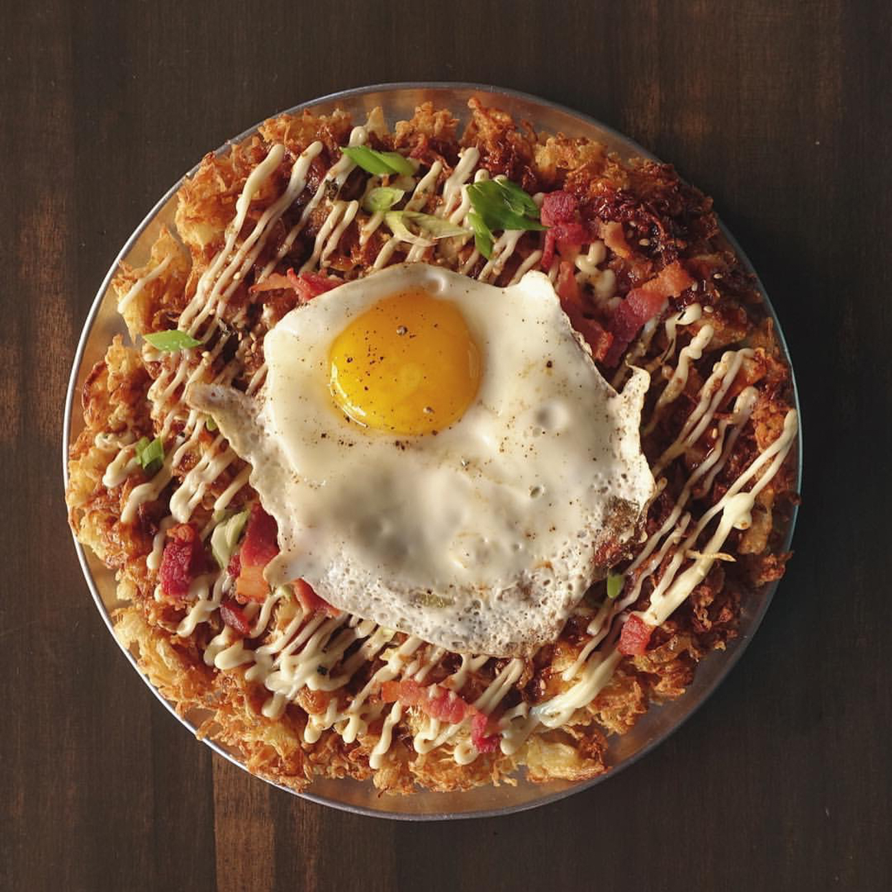 House Okonomiyaki: Japanese mayo, tonkatsu, bacon, green onion, and a fried egg / Image courtesy of Quan Hapa // Published: 1.10.17