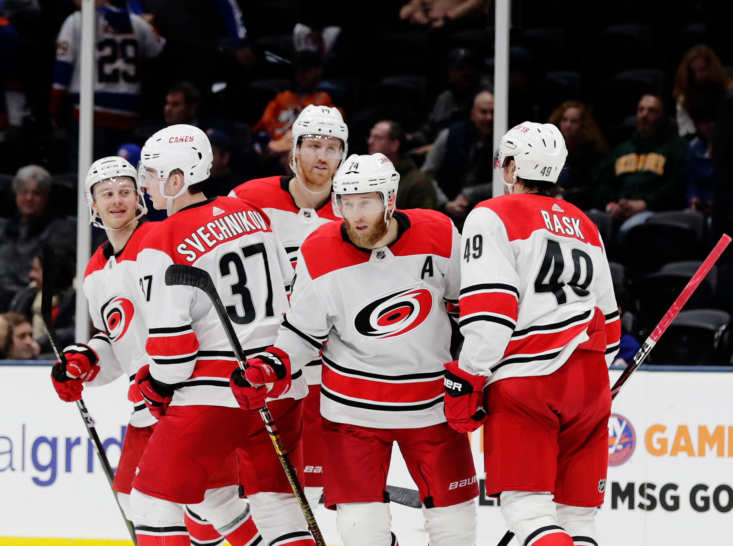 Carolina Hurricanes' Jaccob Slavin, center, celebrates with teammates after scoring a goal during the third period of an NHL hockey game against the New York Islanders Tuesday, Jan. 8, 2019, in New York. The Hurricanes won 4-3. (AP Photo/Frank Franklin II)