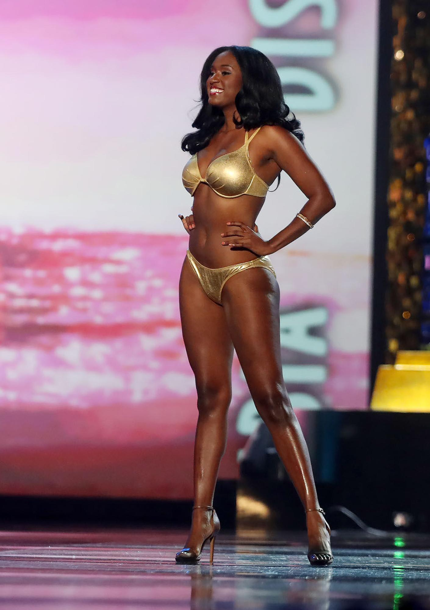 Miss District of Columbia 2017, Briana Kinsey, walks the stage in the fitness competition during second night of Miss America 2018 preliminaries at Boardwalk Hall, in Atlantic City, N.J. Thursday Sept. 7, 2017 . (Edward Lea/The Press of Atlantic City via AP)