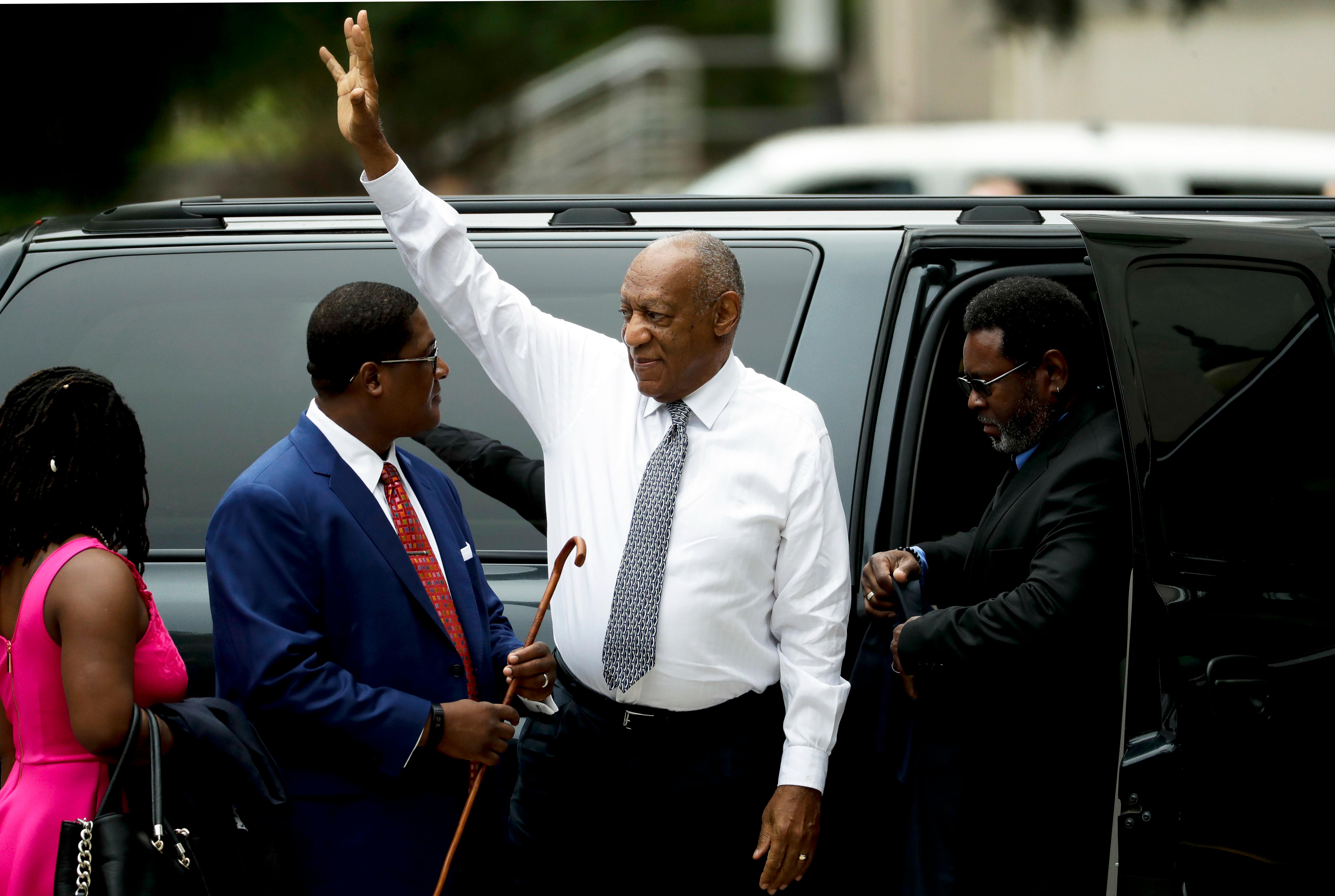 Bill Cosby waves as he arrives at the Montgomery County Courthouse during his sexual assault trial, Friday, June 16, 2017, in Norristown, Pa. (AP Photo/Matt Slocum)