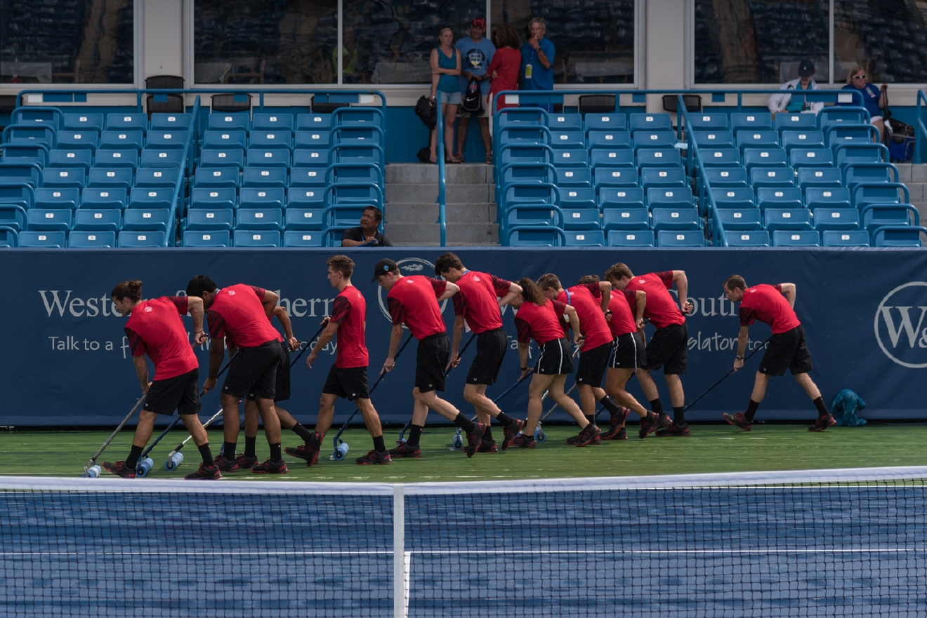 The ball kids getting to work drying Center Court / Image: Phil Armstrong, Cincinnati Refined