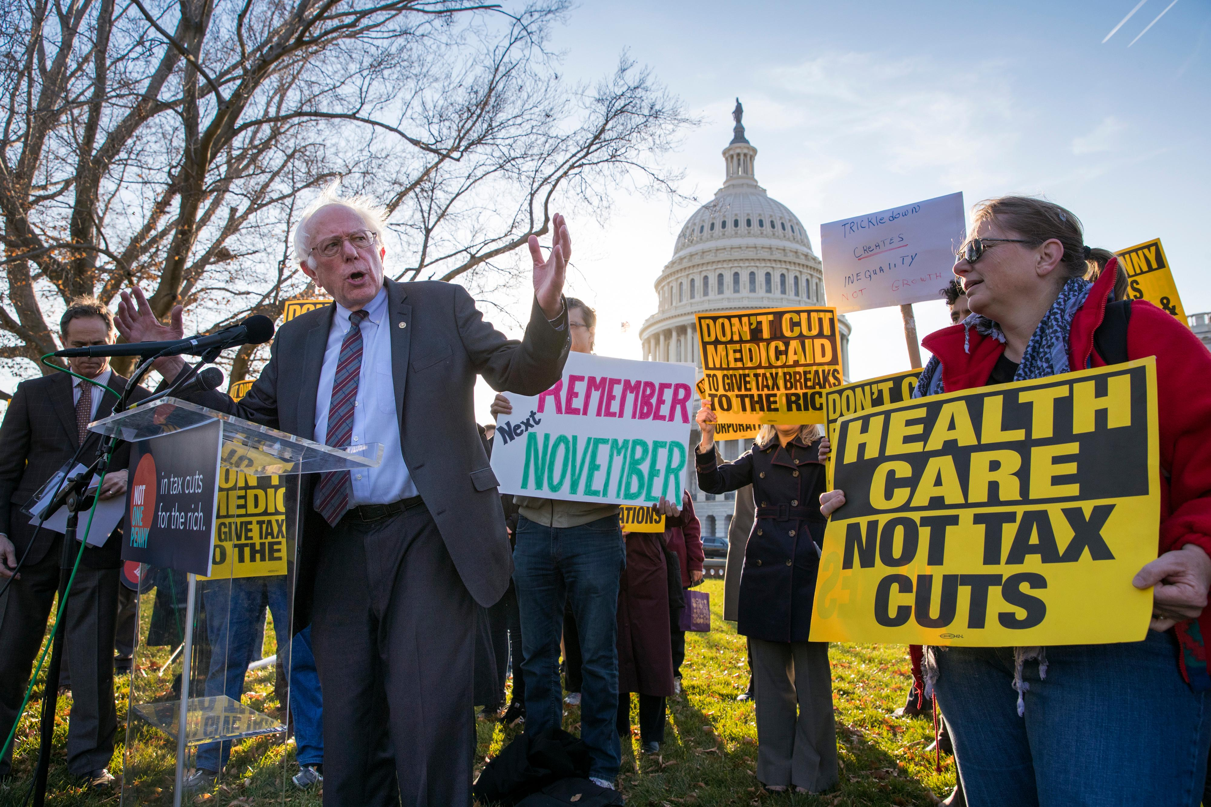 Sen. Bernie Sanders, I-Vt., joins protesters outside the Capitol as Republicans in the Senate work to pass their sweeping tax bill, a blend of generous tax cuts for businesses and more modest tax cuts for families and individuals, on Capitol Hill in Washington, Thursday, Nov. 30, 2017. It would mark the first time in 31 years that Congress has overhauled the tax code, making it the biggest legislative achievement of President Donald Trump's first year in office. (AP Photo/J. Scott Applewhite)