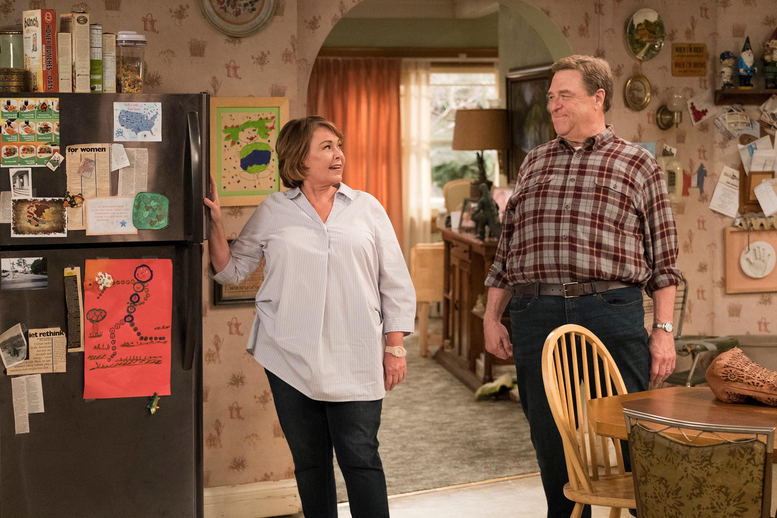 "In this image released by ABC, Roseanne Barr, left, and John Goodman appear in a scene from ""Roseanne."" The unprecedented sudden cancellation of TV's top comedy has left a wave of unemployment and uncertainty in its wake. Barr's racist tweet and the almost immediate axing of her show put hundreds of people out of work. (Adam Rose/ABC via AP)"
