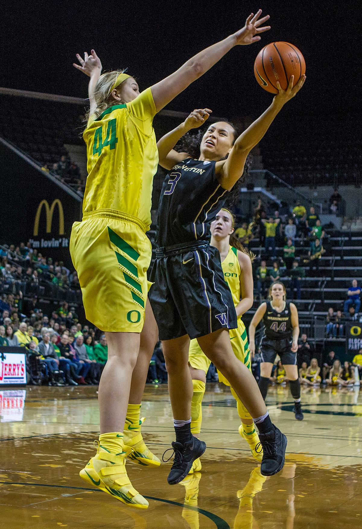 Oregon Ducks Mallory McGwire (#44) attempts to block the shot of Washington Huskies Mai-Loni Henson (#3). The Oregon Ducks defeated the Washington Huskies 94-83 on Sunday at Matthew Knight Arena. The victory was Head Coach Kelly Graves' 500th career win. Sabrina Ionescu also set the new NCAA all time record of 8 triple doubles in just 48 games. The previous record was 7 triple doubles in 124 games, held by Susie McConnell at Penn State. The Ducks will next face off against USC on Friday January 5th in Los Angeles. Photo by Rhianna Gelhart, Oregon News Lab