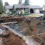 Giant sinkhole swallows Lynden street as record rains cause landslides around Puget Sound