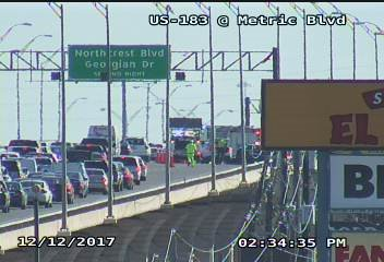 A motorcyclist was thrown off the Hwy 183 upper deck in North Austin Tuesday afternoon after a crash with another vehicle, EMS officials say. (Image courtesy: TxDOT)