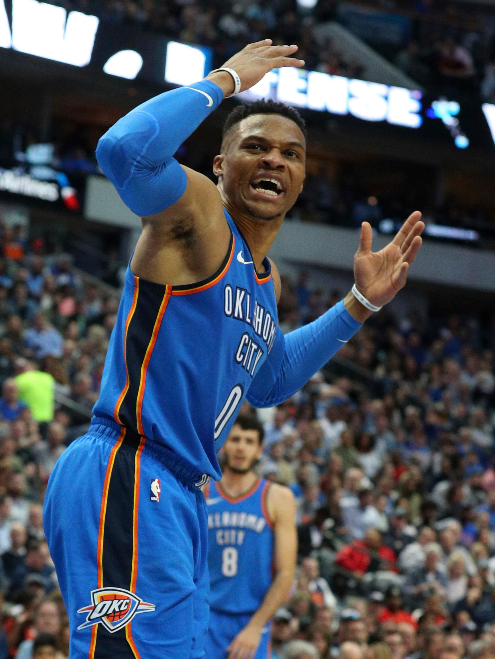 Oklahoma City Thunder guard Russell Westbrook (0) reacts after being fouled during the first half of an NBA basketball game against the Dallas Mavericks, Wednesday, Feb. 28, 2018 in Dallas. (AP Photo/Richard W. Rodriguez)