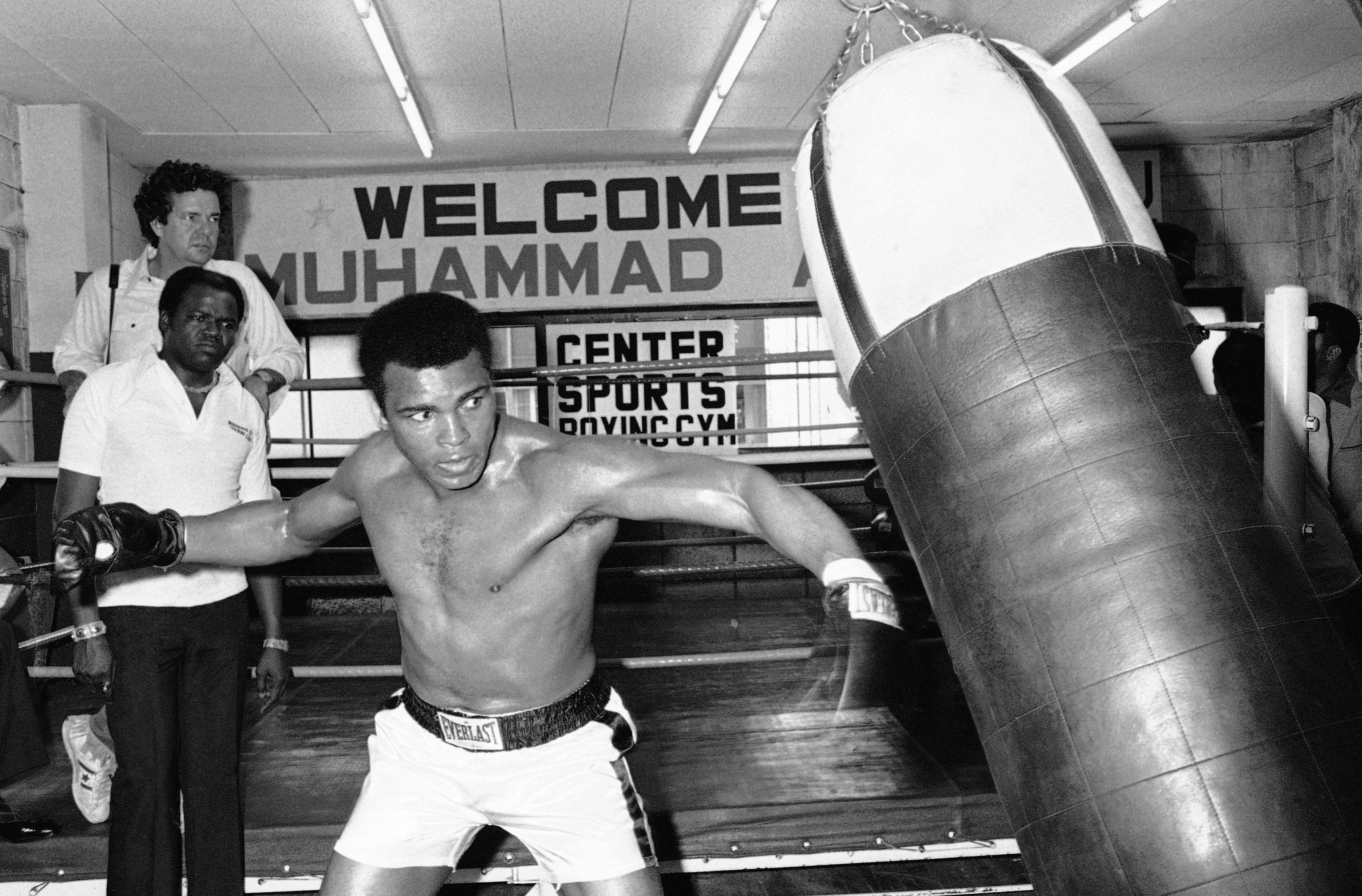 In this Wednesday, June 23, 1976, file photo, Muhammad Ali throws a left punch at a sandbag during workout at a gym in Tokyo. Later in the week, the world heavyweight boxing champion met Japanese pro wrestler Antonio Inoki in the world's Martial Arts Championship. NICK UT/THE ASSOCIATED PRESS
