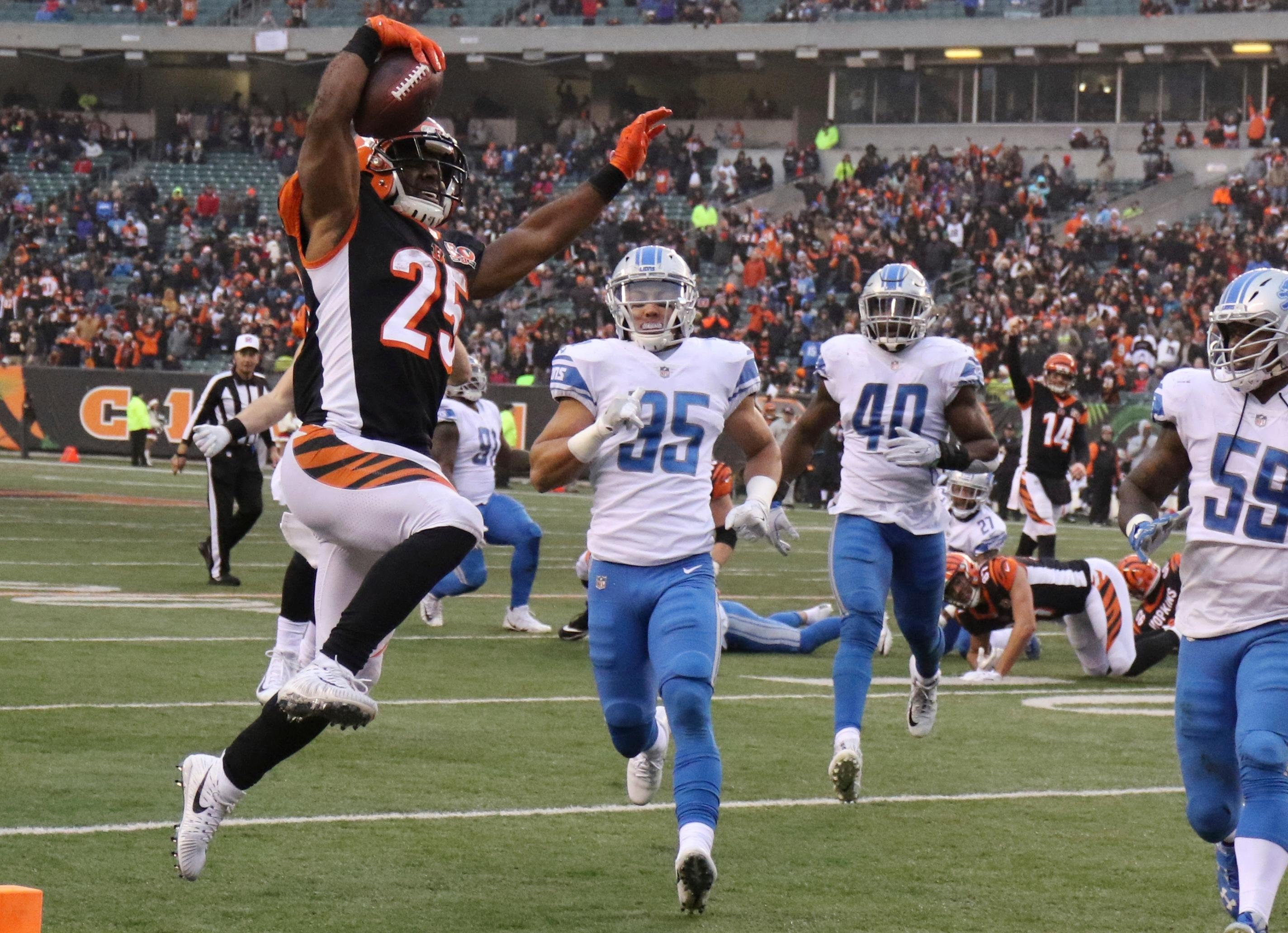 Cincinnati Bengals running back Giovani Bernard (25) jumps into the end zone for a 12-yard rushing touchdown during the second half of an NFL football game against the Detroit Lions, Sunday, Dec. 24, 2017, in Cincinnati. (AP Photo/Gary Landers)