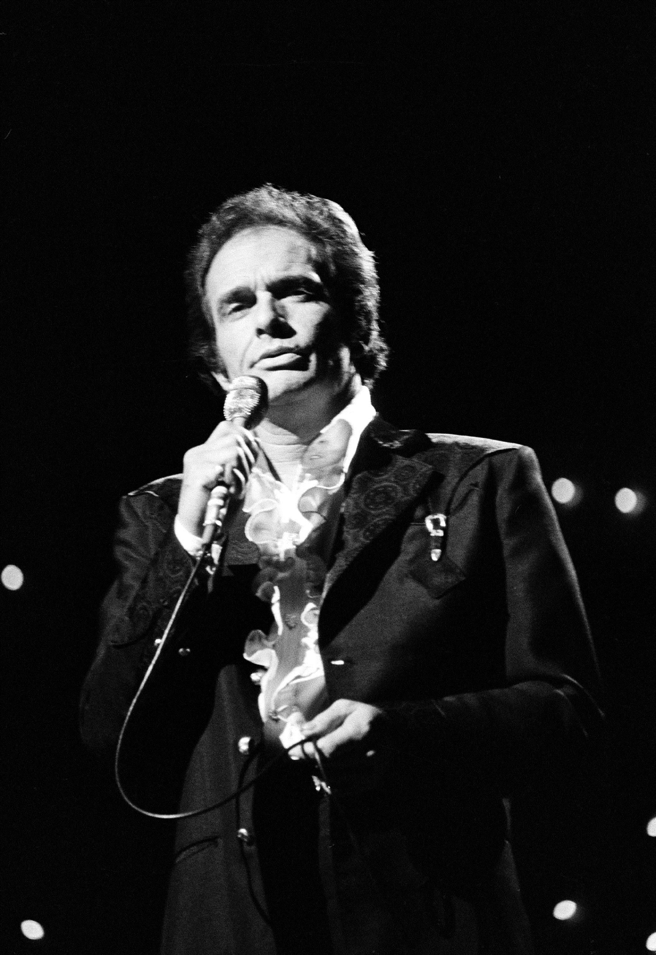 In this Oct. 8, 1977 file photo, Merle Haggard performs at the Country Music Association Awards in Nashville, Tenn. Haggard died of pneumonia, Wednesday, April 6, 2016, in Palo Cedro, Calif. He was 79. (AP Photo/Mark Humphrey, File)