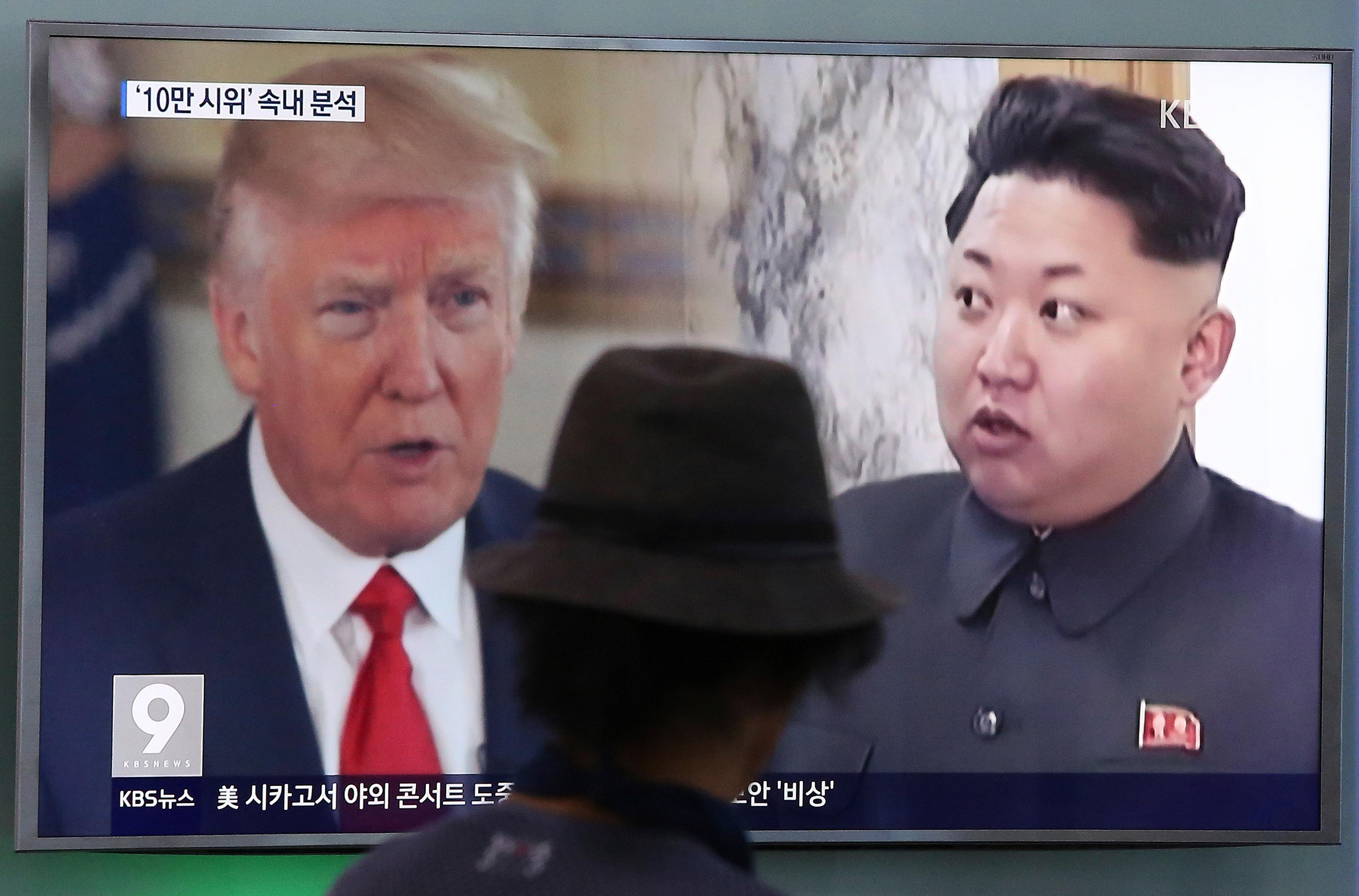 "FILE - In this Aug. 10, 2017, file photo, a man watches a television screen showing U.S. President Donald Trump and North Korean leader Kim Jong Un during a news program at the Seoul Train Station in Seoul, South Korea.  South Korea's national security director says President Donald Trump has decided he will meet with North Korea's Kim Jong Un ""by May.""Chung Eui-yong spoke outside the White House, Thursday, March 8, 2018,  after a day of briefings with senior U.S. officials, including Trump, on the recent inter-Korea talks. Chung says Trump said ""he would meet Kim Jong Un by May to achieve permanent denuclearization"" of the Korean peninsula. (AP Photo/Ahn Young-joon, File)"
