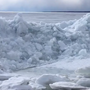 WATCH: Wind moving ice piles onshore on Oneida Lake