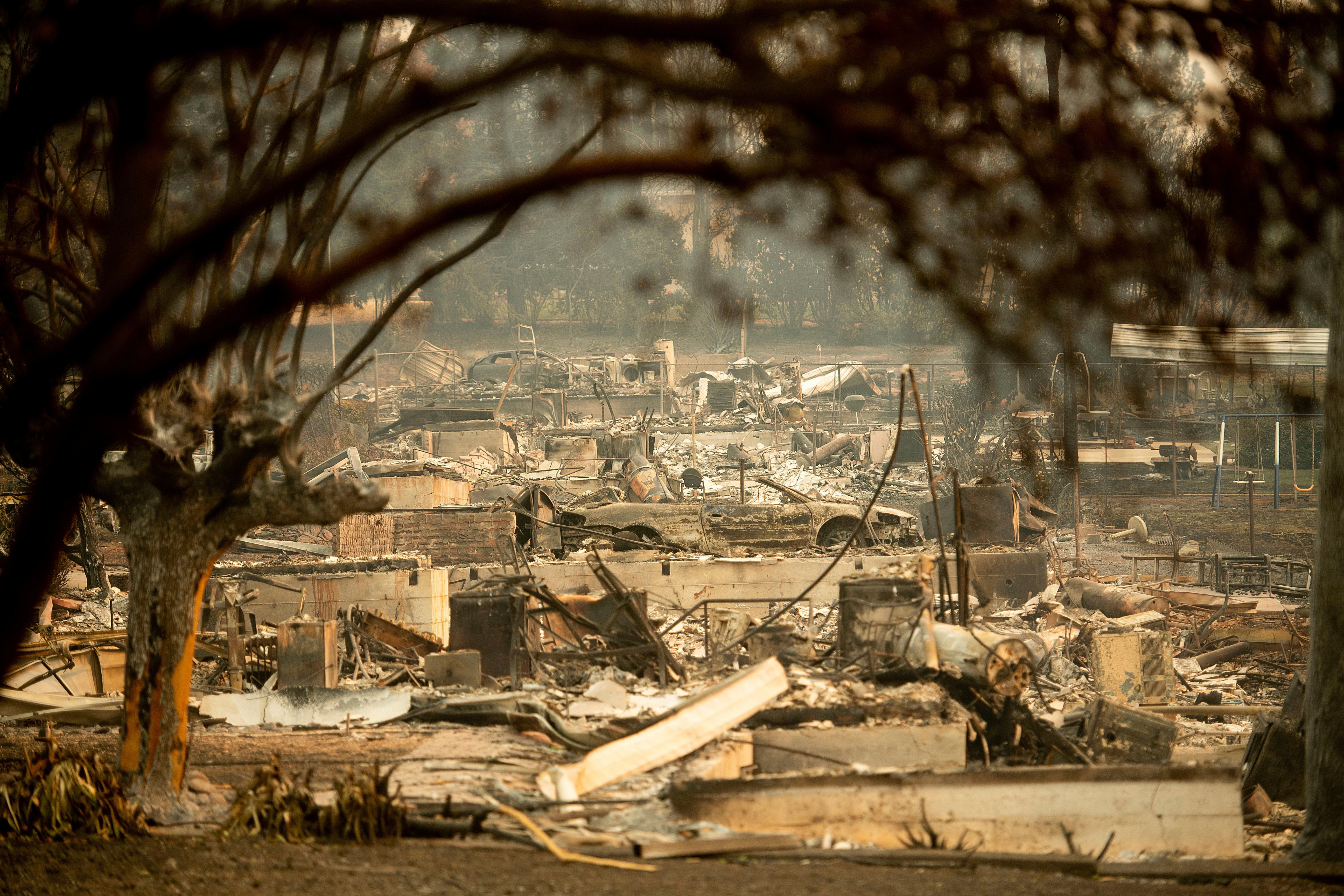 Leveled residences line a block following the Camp Fire in Paradise, Calif., on Monday, Nov. 12, 2018. (AP Photo/Noah Berger)