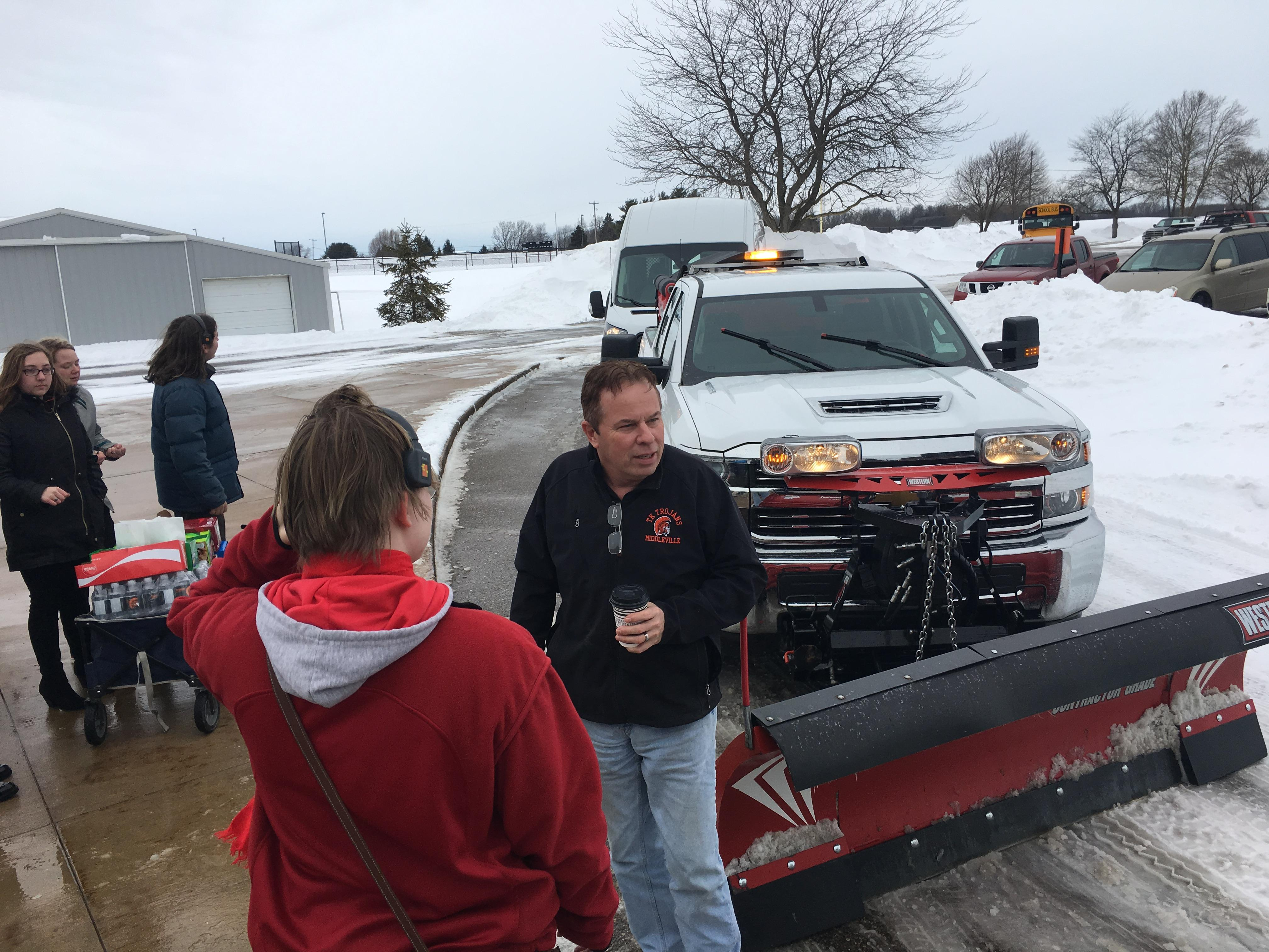 Thornapple Kellogg High school students give treats, beverages and words of  encouragement to a Middleville plow worker, they were handing out treats from 11 a.m. to 1 p.m. Feb. 14, 2019.{ } (WWMT/ Will Haenni)