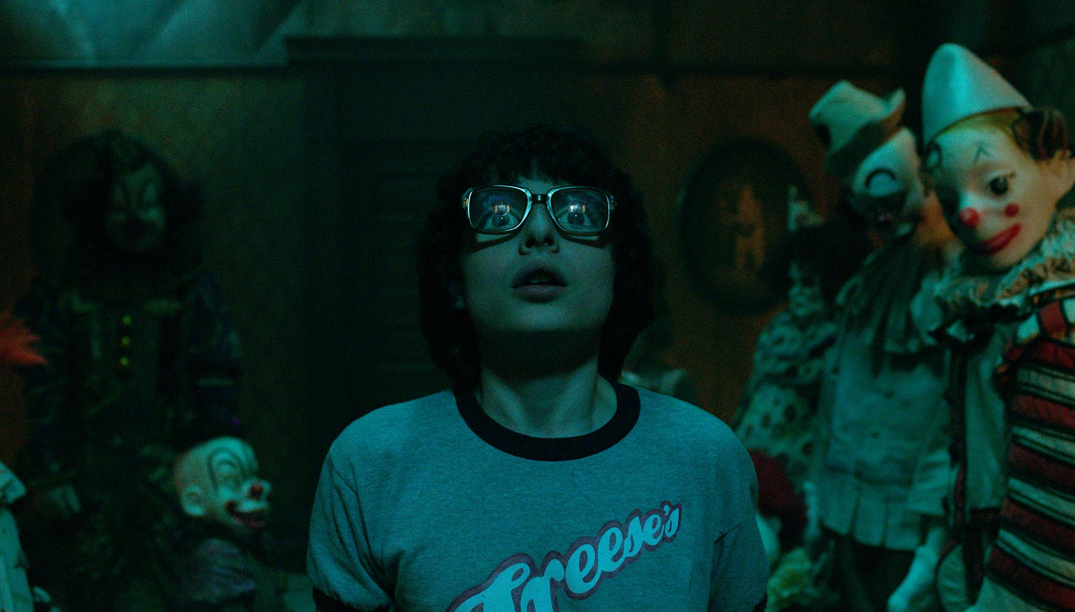 "(L-R) FINN WOLFHARD as Richie Tozier in New Line Cinema's horror thriller ""IT,"" a Warner Bros. Pictures release. Photo Credit: Brooke Palmer"