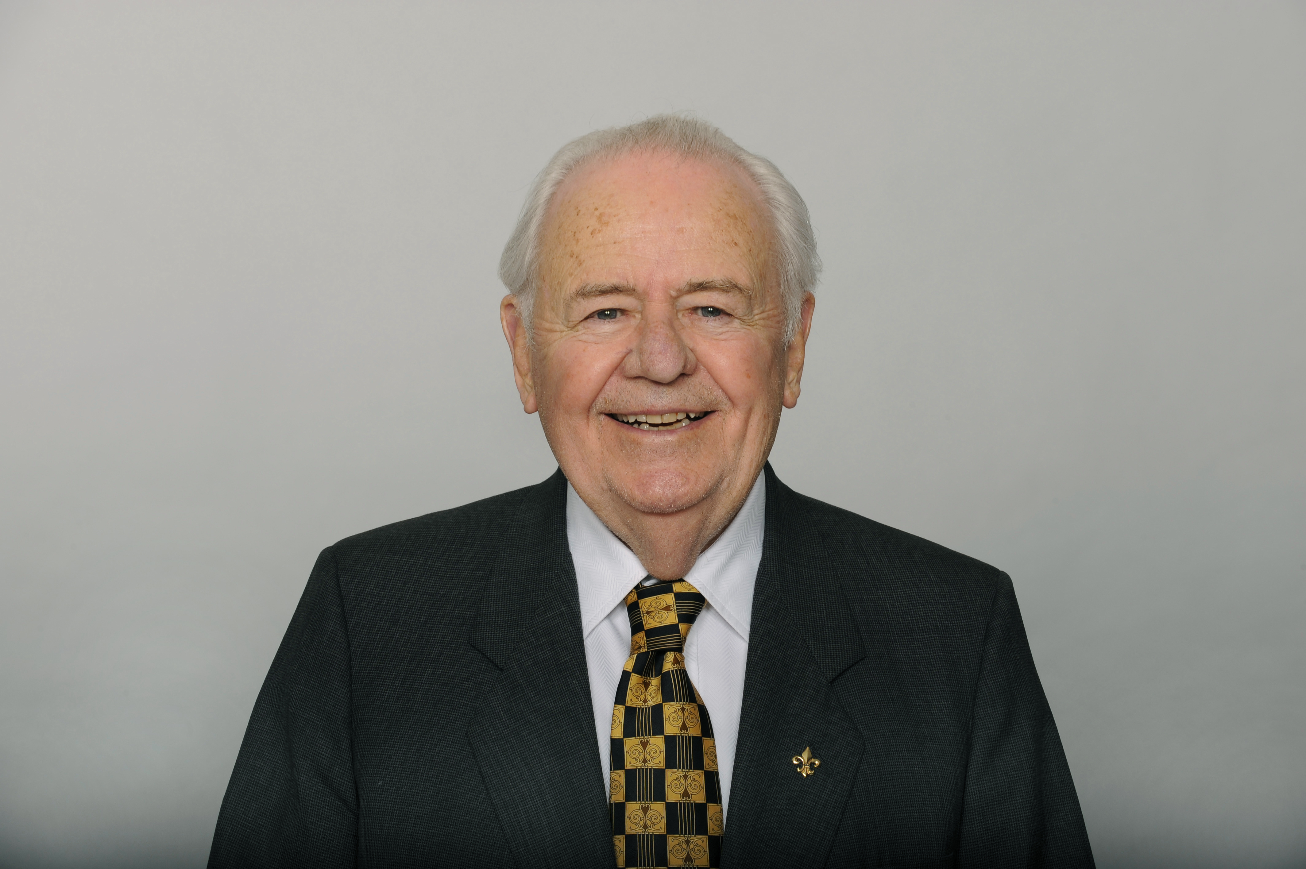 "File-This June 17, 2016, file photo shows Tom Benson of the New Orleans Saints NFL football team. Benson, a successful auto dealer who brought the New Orleans Saints their only winning seasons and the ""Benson Boogie,"" has died. Benson, who has also owned the NBA's New Orleans Pelicans since 2012, was 90. The NFL and NBA teams announced Benson's death on Thursday,  March 15, 2018.  (AP Photo/File)"