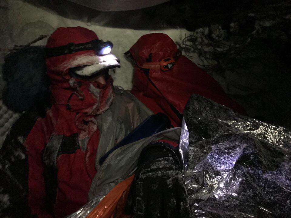 Search and rescue teams wrap up hiker to keep him warm overnight before getting a helicopter to airlift him to a local hospital. (Courtesy of Yakima County Search and Rescue.)<p></p>