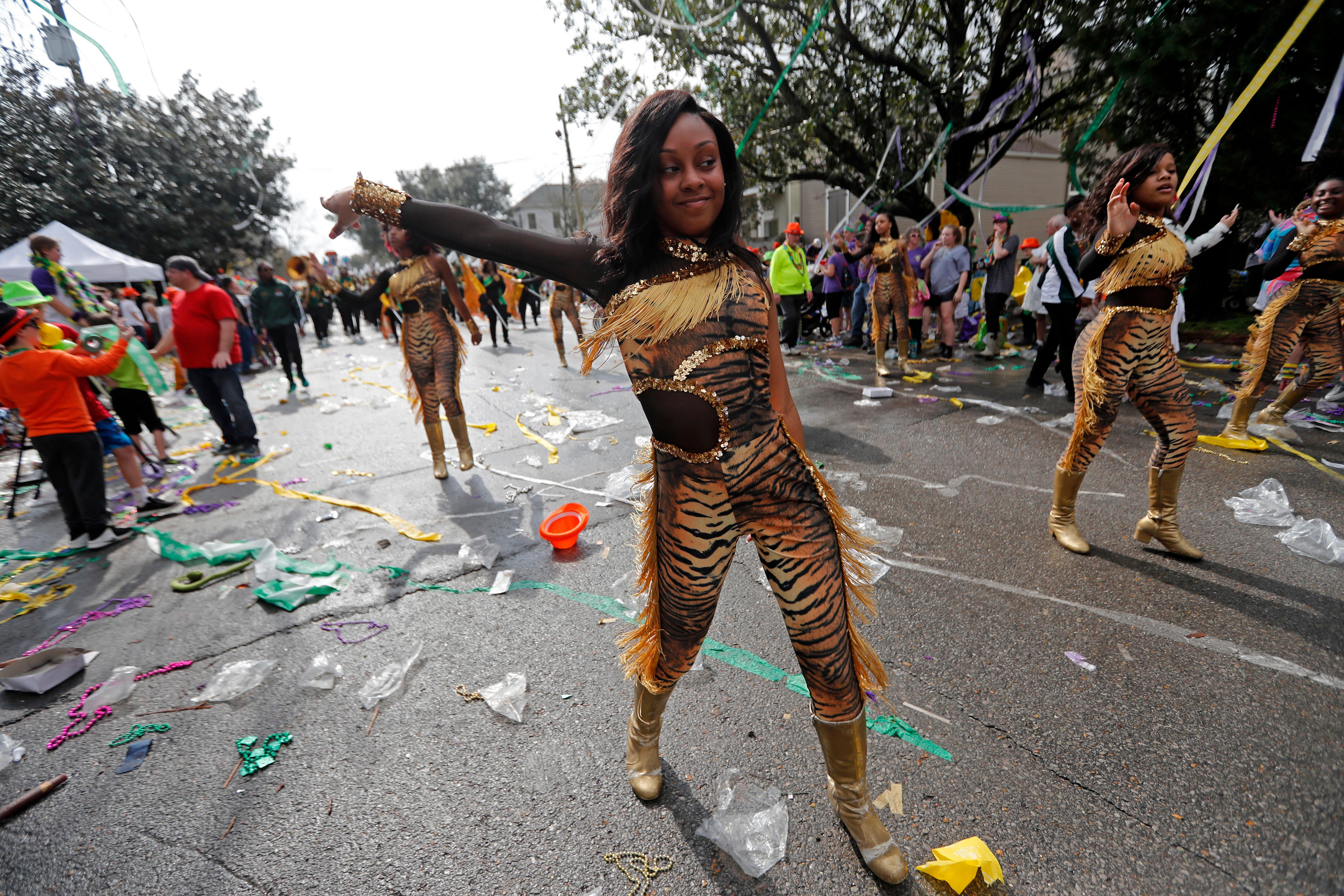 Dancers from Jim Hill High School of Jackson, Miss. march during the Krewe of Thoth Mardi Gras parade in New Orleans, Sunday, Feb. 11, 2018. The krewe's original parade route was designed specifically to serve people who were unable to attend other parades in the city. The route passes in front of several extended healthcare facilities. Carnival season will culminate on Mardi Gras day this Tuesday, Feb. 13. (AP Photo/Gerald Herbert)