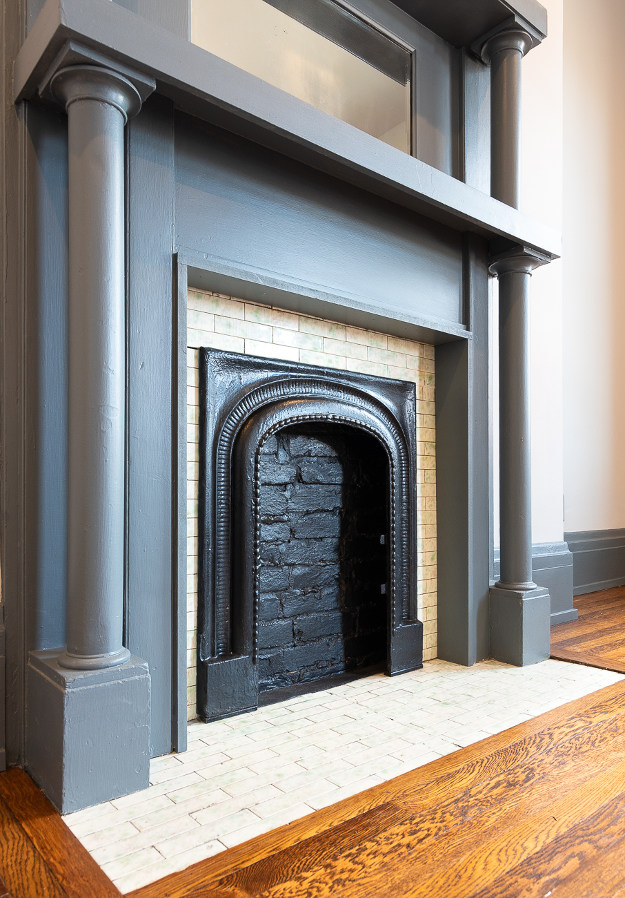 The fireplace surround was added, but the tile and mantle are original to the house. / Image: Phil Armstrong, Cincinnati Refined // Published: 3.15.19