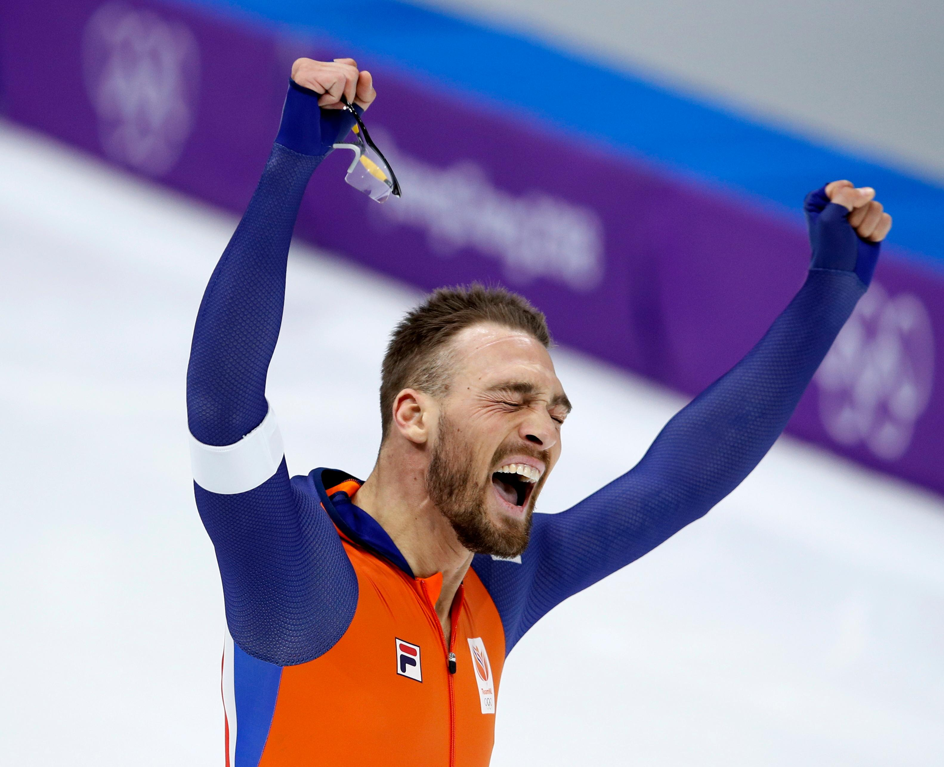 Gold medalist Kjeld Nuis of The Netherlands celebrates after the men's 1,000 meters speedskating race at the Gangneung Oval at the 2018 Winter Olympics in Gangneung, South Korea, Friday, Feb. 23, 2018. (AP Photo/Vadim Ghirda)