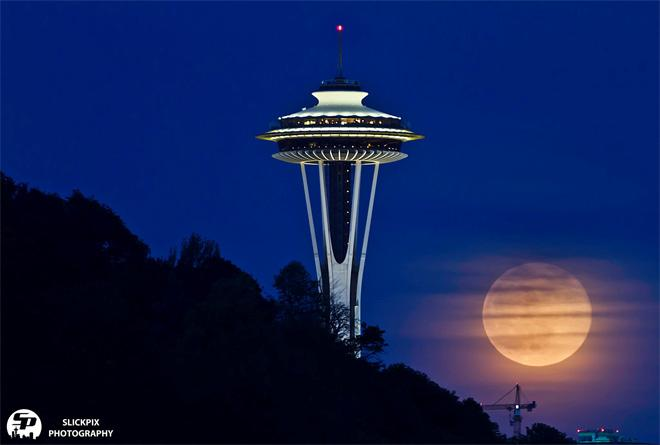 The full moon rises near the Space Needle, taken from the Magnolia Bridge on May 14, 2014. Photo: David Rosen / SlickPix Photography