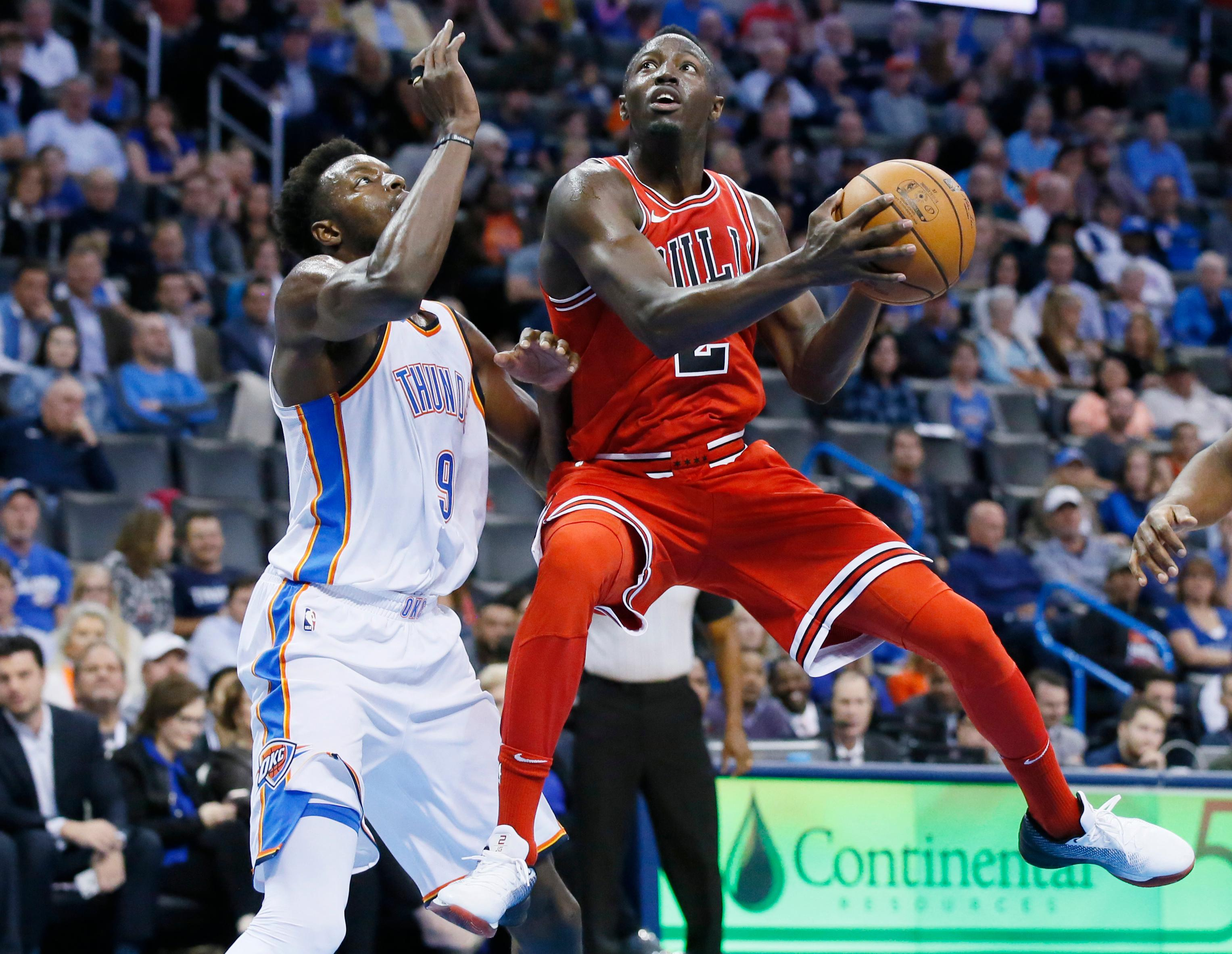 Chicago Bulls guard Jerian Grant (2) goes to the basket in front of Oklahoma City Thunder forward Jerami Grant, left, in the second quarter of an NBA basketball game in Oklahoma City, Wednesday, Nov. 15, 2017. (AP Photo/Sue Ogrocki)