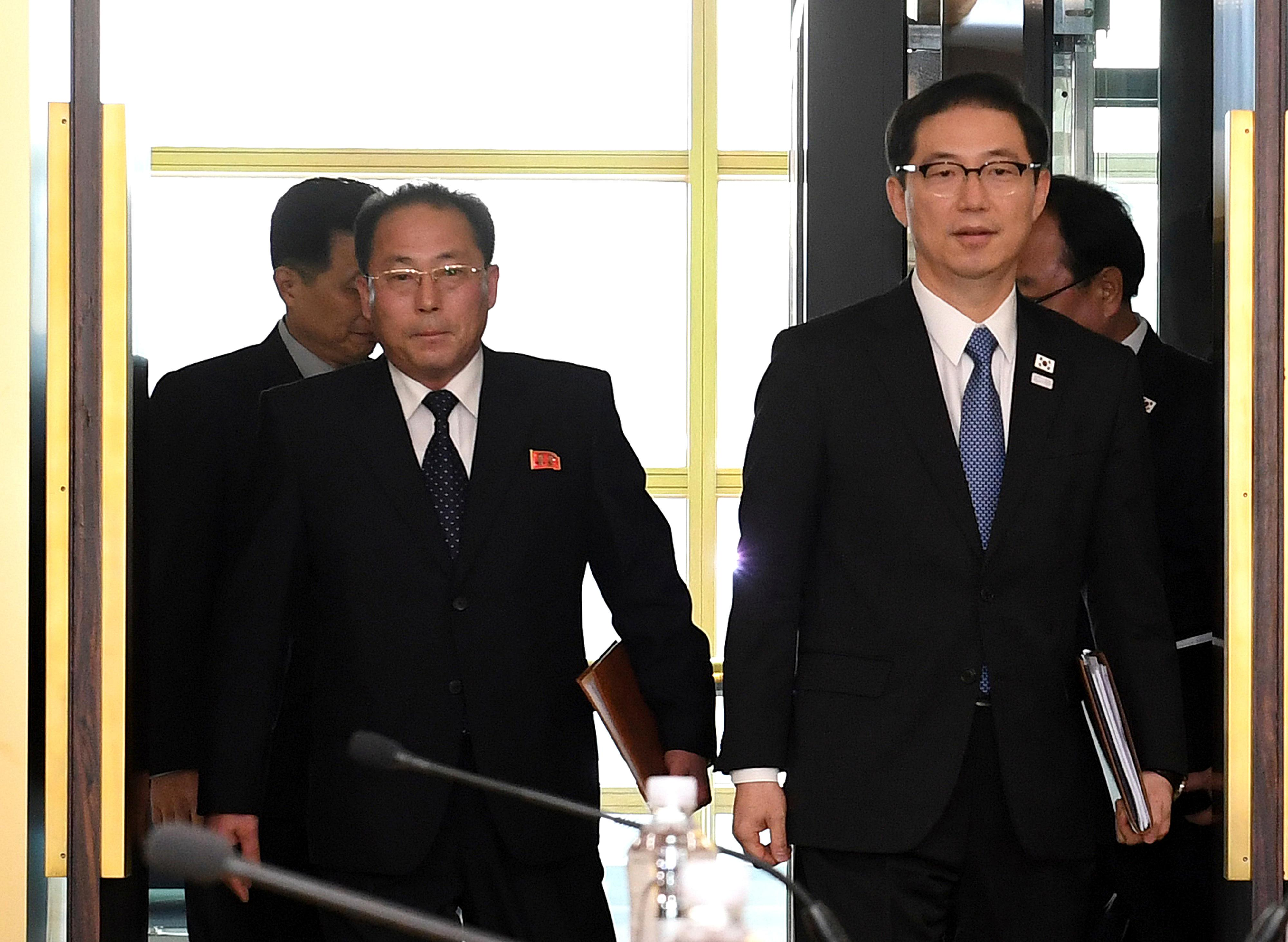 In this photo provided by South Korea Unification Ministry, South Korean Vice Unification Minister Chun Hae-sung, right, and the head of North Korean delegation Jon Jong Su arrive for their meeting at Panmunjom in the Demilitarized Zone in Paju, South Korea, Wednesday, Jan. 17, 2018. The two Koreas are meeting Wednesday for the third time in about 10 days to continue their discussions on Olympics cooperation, days ahead of talks with the IOC on North Korean participation in the upcoming Winter Games in the South. (South Korea Unification Ministry via AP)