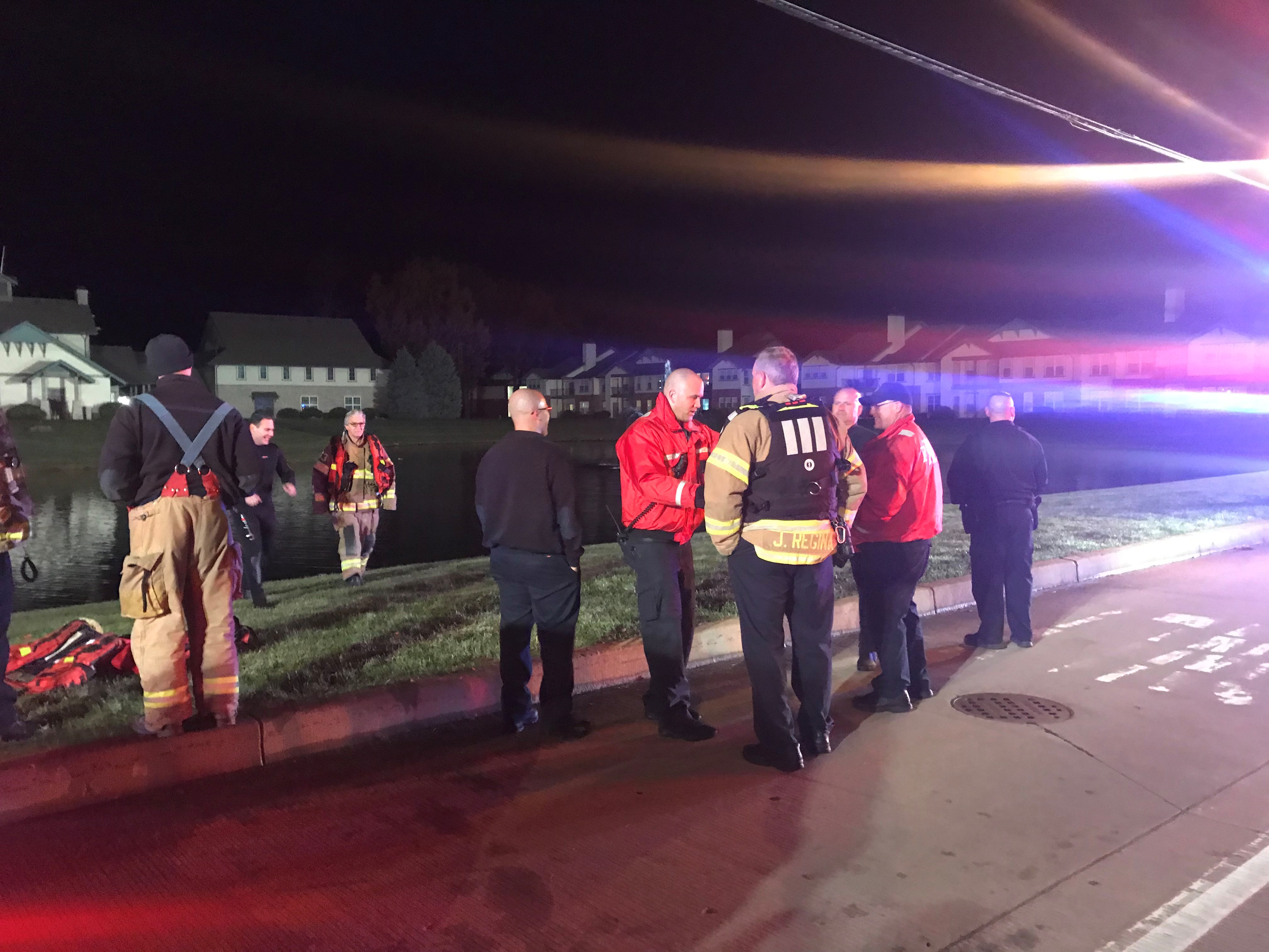 Mishawaka firefighter and police officer pull man from car in Mishawaka pond. // WSBT 22 Photo