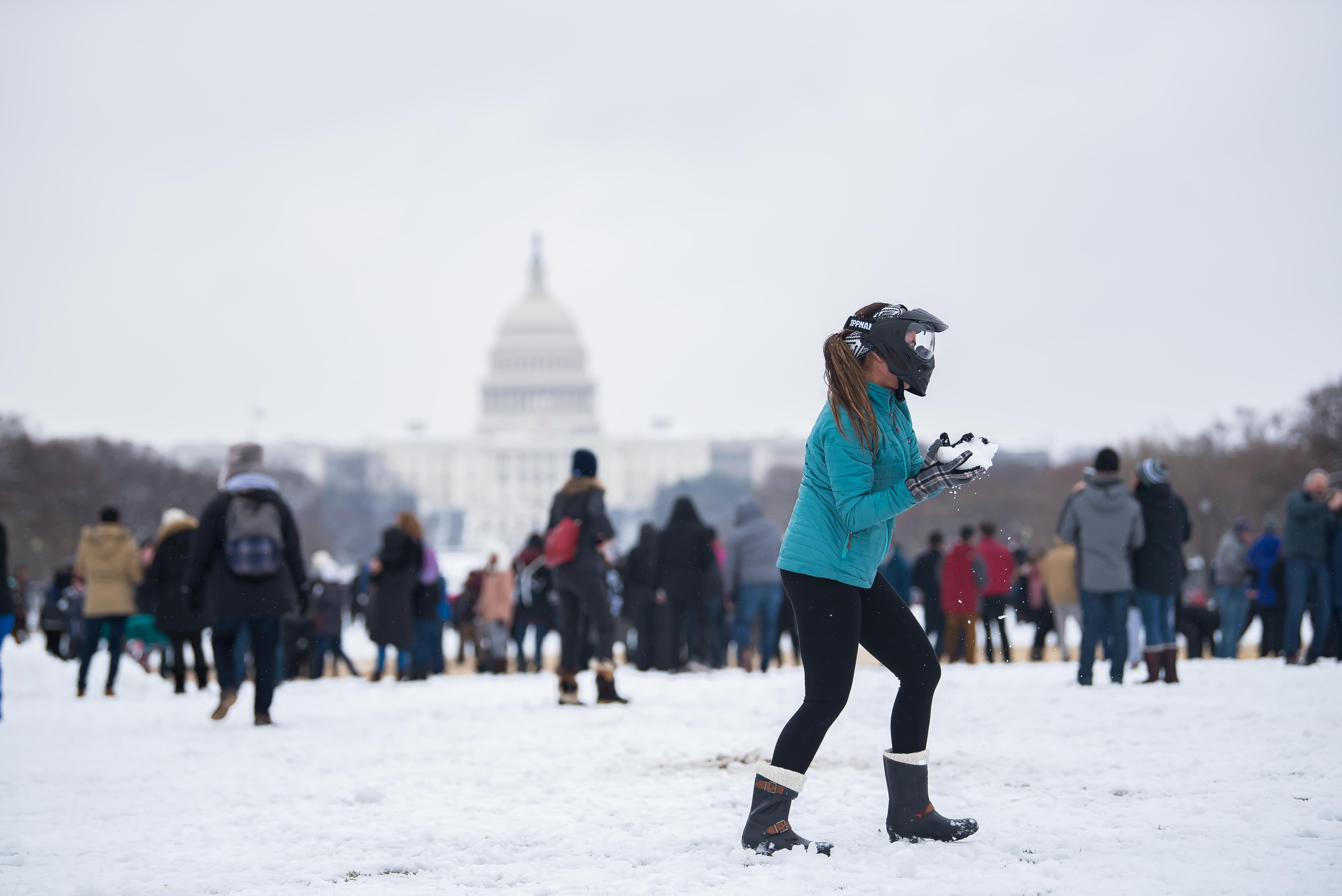 "The first full day of spring in D.C. was looking pretty wintry, as snow blanketed the DMV.{ } Even though the District only accumulated about four inches, Washingtonians celebrated the ""biggest snowfall of the season"" by gathering on the National Mall for a huge snowball fight. There's nothing like a good snow day to bring out the kid in all of us! (Image: Joy Asico/ DC Refined)"