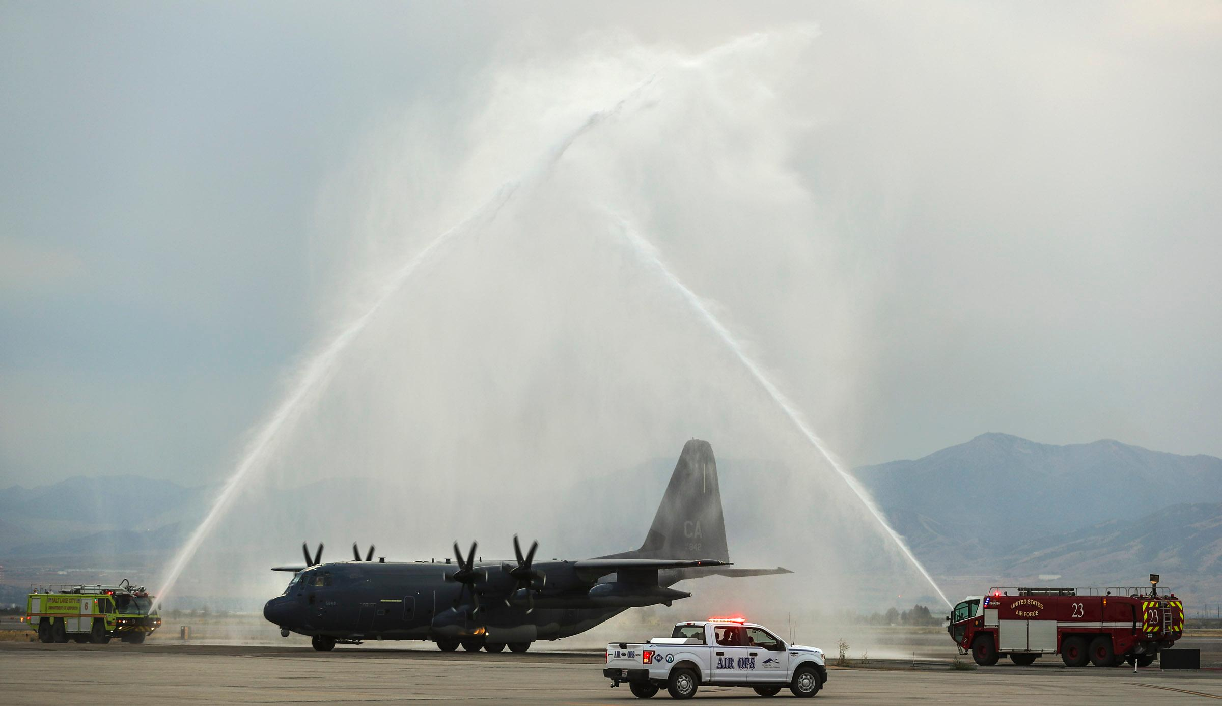 A  C130-J carrying the  casket of Draper Battalion Chief Matt Burchett taxis through a water arch as it lands at the Utah Air National Guard Base in Salt Lake City on Wednesday, Aug. 15, 2018. Burchett was killed while fighting the Mendocino Complex Fire north of San Francisco.