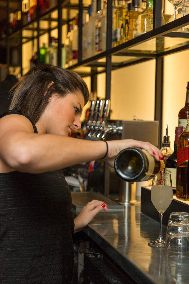 One of the lovely bartenders crafting a champagne vodka cocktail. (Image: Daniel Smyth Photography)