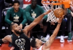 Toronto Raptors guard Norman Powell (24) is fouled by Milwaukee Bucks center Greg Monroe (15) as he drives to the basket during the second half in Game 5 of a first-round NBA playoff series in Toronto on Monday, April 24, 2017.