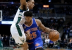 New York Knicks' Derrick Rose (25) drives to the basket against Milwaukee Bucks' Malcolm Brogdon Wednesday, March 8, 2017, in Milwaukee.