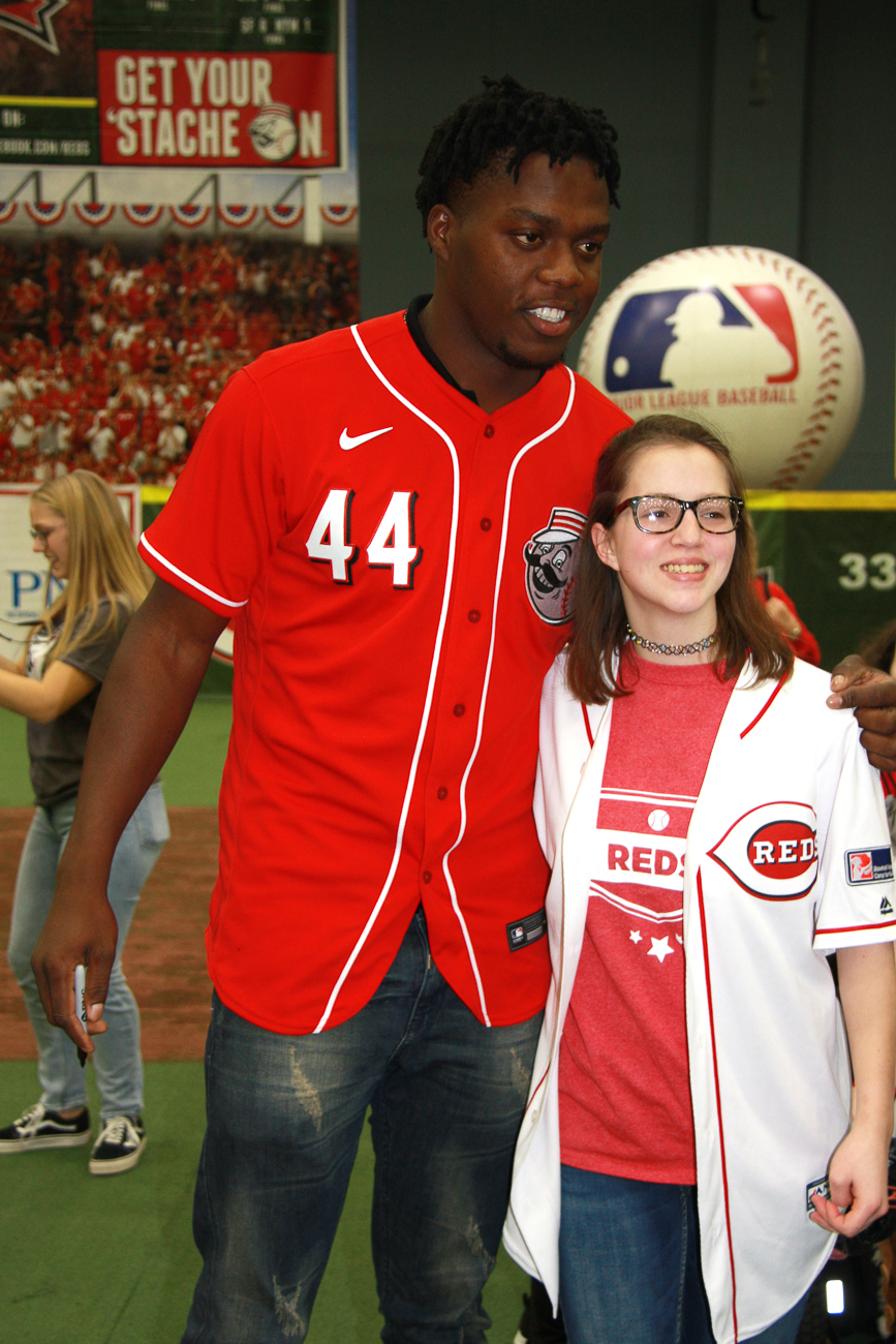 Aristides Aquino, right fielder #44, takes a photo with a fan