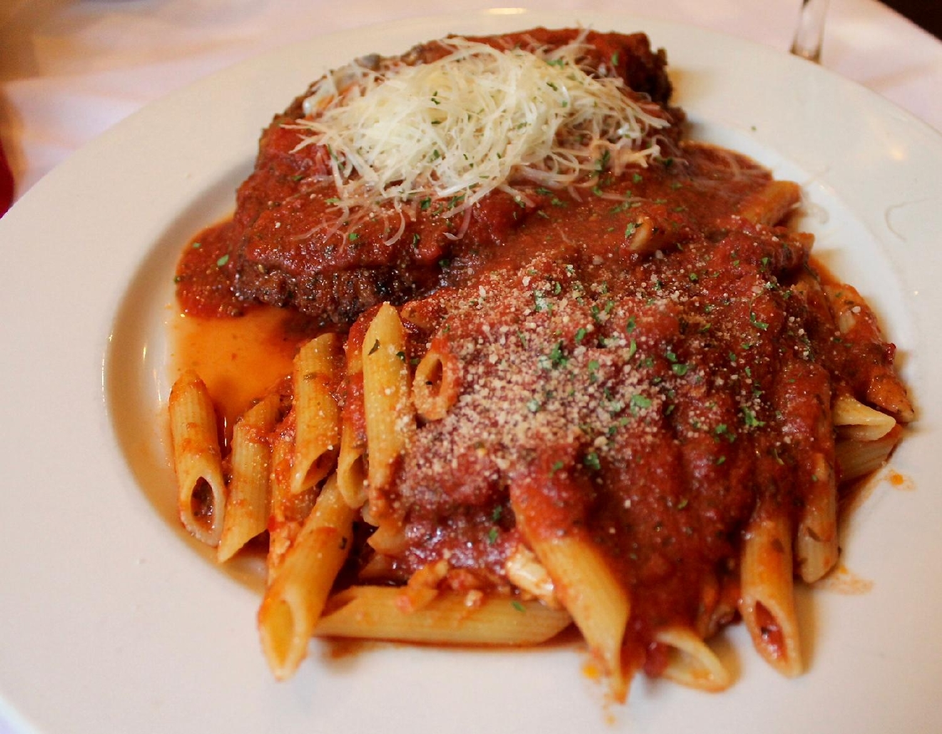 Pollo Parmesan: chicken milanese, provalone cheese, marinara sauce, and rigatoni / Image: Rose Brewington