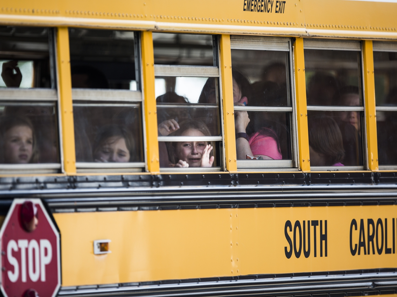 A Townville Elementary student looks out of the window of a school bus as she and her classmates are transported to Oakdale Baptist Church, following a shooting at Townville Elementary in Townville Wednesday, Sept. 28, 2016. (Katie McLean/The Independent-Mail via AP)