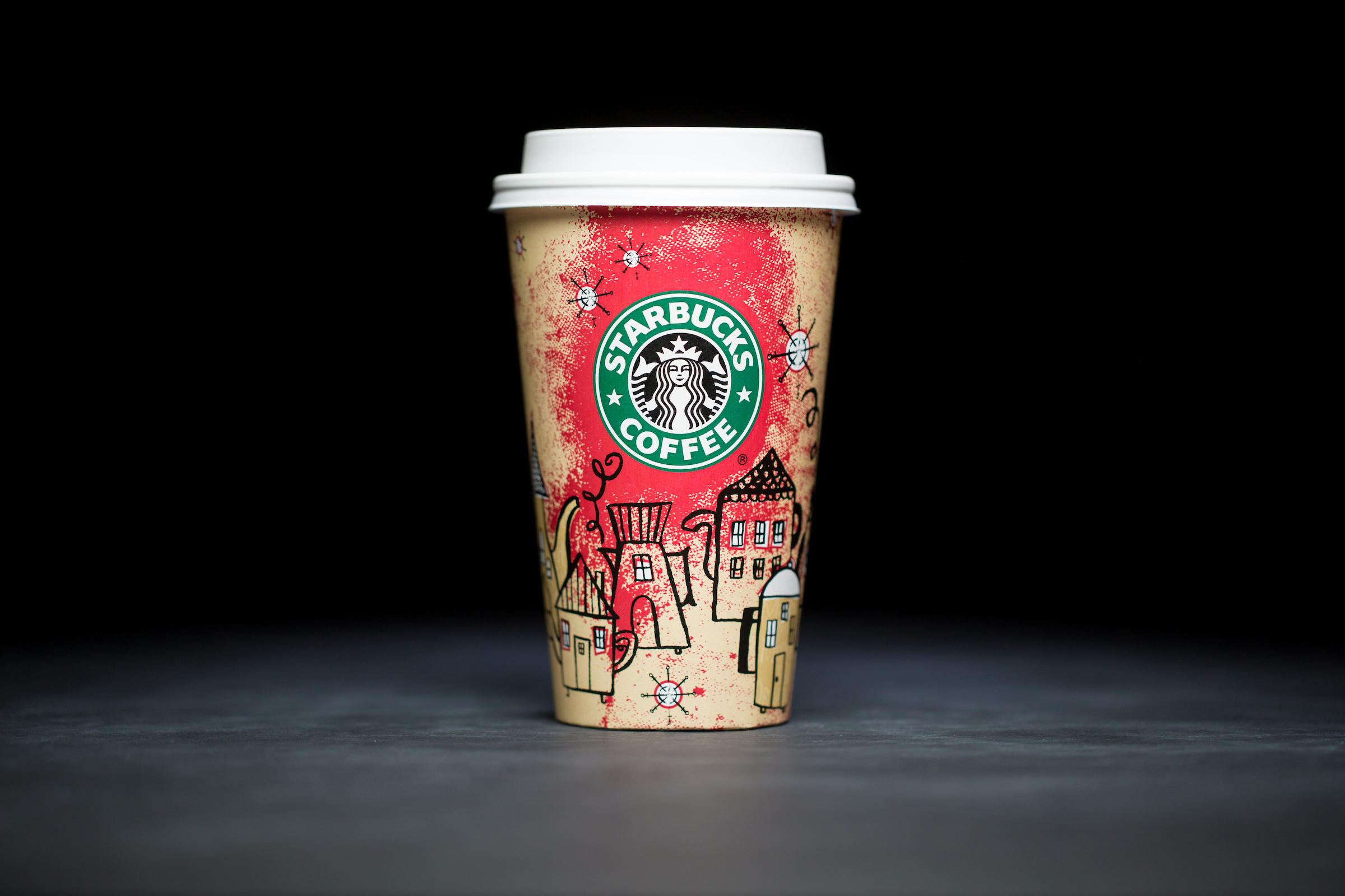 2000: For 20 years, Starbucks have released a range of holiday cup designs, most of them based around their world famous red cup. It's not easy to find the very first Starbucks holiday cups, which made their debut in stores in 1997. Few were saved, and electronic design files were lost in an earthquake in 2001. Even an Internet search is unyielding, with the cups having made their arrival long before the first selfie. But, we have them here! Click on for a photos of all 20 holidays cup designs. (Image: Joshua Trujillo/Cover Images)
