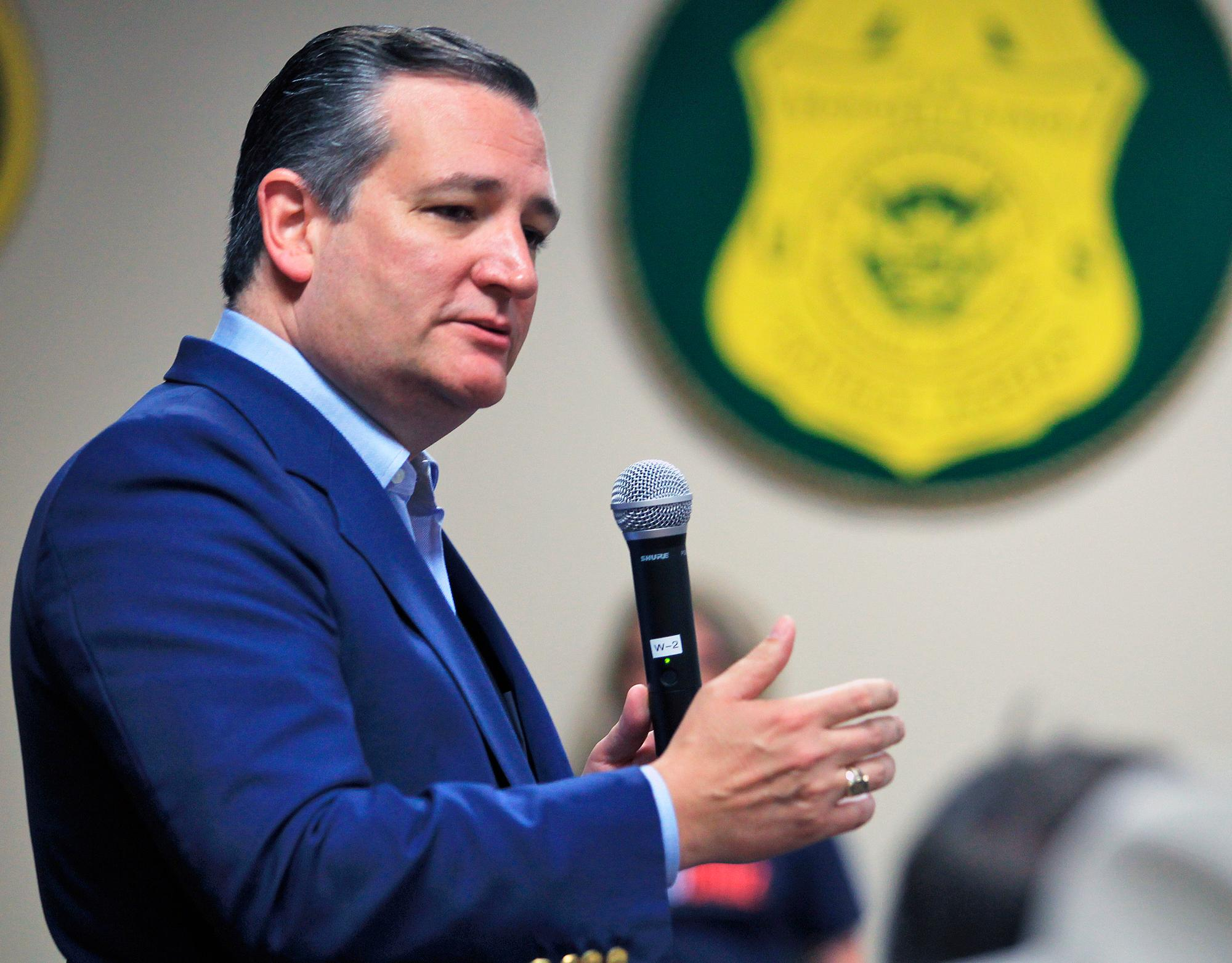 FILE - In this April 3, 2018, file photo, U.S. Senator Ted Cruz, R-Texas, speaks to supporters as he campaigns for re-election at the National Border Patrol Council Local 3307 offices in Edinburg, Texas. (Joel Martinez/The Monitor via AP, File)