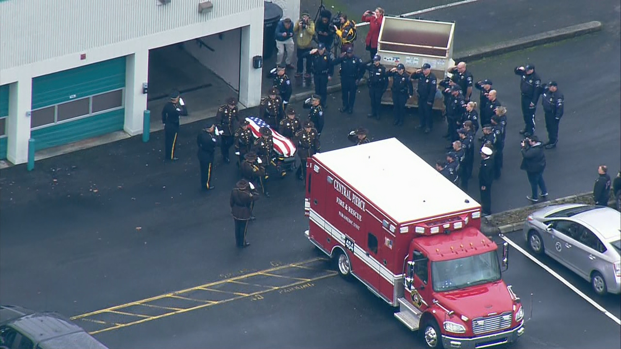 Dozens of law enforcement units escort an ambulance with the body of fallen Pierce County Sheriff's Deputy Daniel McCartney from the Medical Examiner's Office to a funeral home in Lakewood, Wash. on Tuesday, Jan. 9, 2018. (Photo: KOMO News/Air 4)