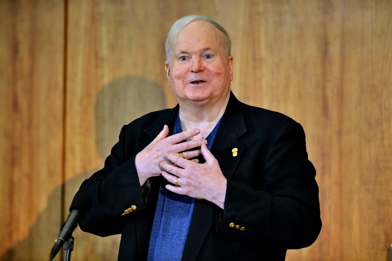 FILE - In this May 16, 2014, file photo, author Pat Conroy speaks to a crowd during a ceremony at the Hollings Library in Columbia, S.C. Conroy, whose best-selling novels drew from his own sometimes painful experiences and evoked vistas of the South Carolina coast and its people, has died at age 70. Todd Doughty, executive director of publicity at publisher Doubleday, says Conroy died Friday evening, March 4, 2016, at his home in Beaufort surrounded by family and loved ones. (AP Photo/ Richard Shiro, File)