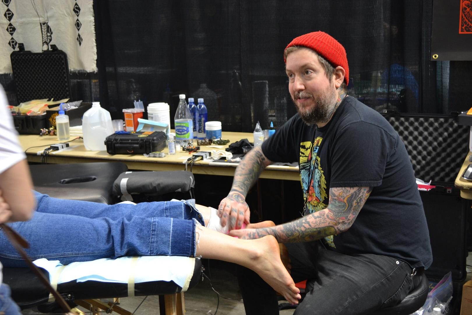 Some of the best tattoo artists are at Century Link Arena in Boise for the first ever Treasure Valley Tattoo Convention. The three-day event features artists, vendors, food, beer and of course, tattoo. (KBOI Staff Photo)