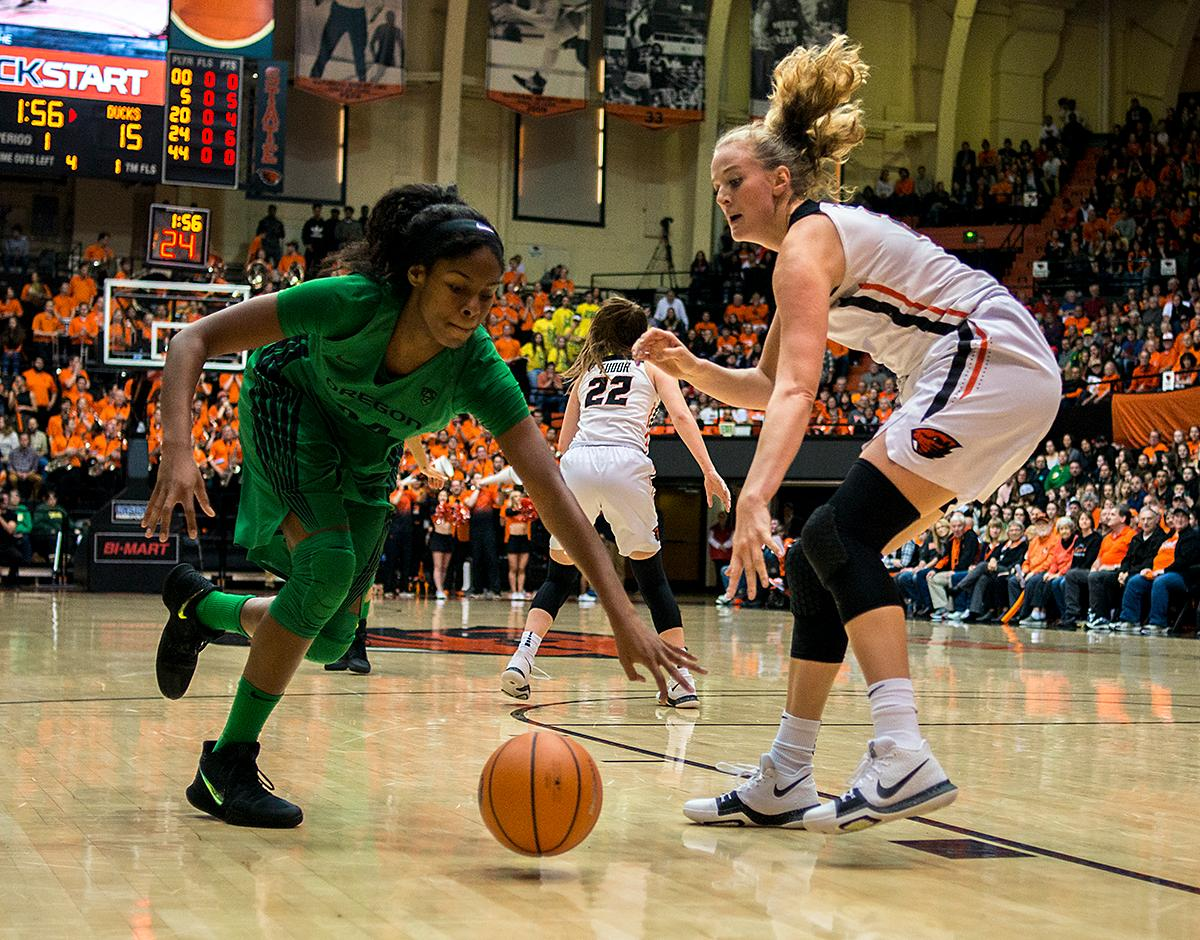 Oregon Ducks forward Ruthy Hebard (#24) chases a loose ball as the Oregon State Beavers defense follows suit.The Oregon Ducks were defeated by the Oregon State Beavers 85-79 on Friday night in Corvallis. Sabrina Ionescu scored 35 points and Ruthy Hebard added 24. The Ducks will face the Beavers this Sunday at 5 p.m. at Matthew Knight Arena. Photo by Abigail Winn, Oregon News Lab
