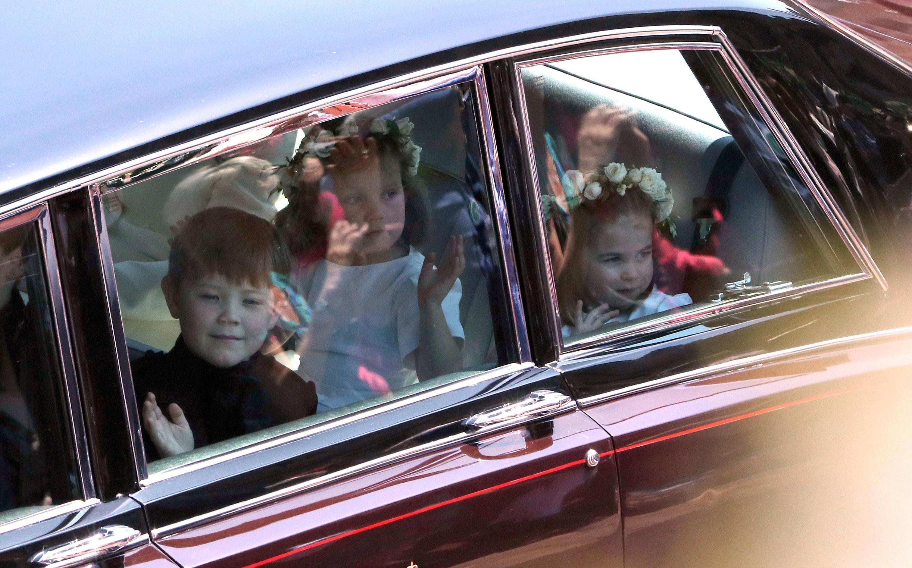 Princess Charlotte, right, arrives for the wedding ceremony of Prince Harry and Meghan Markle at St. George's Chapel in Windsor Castle in Windsor, near London, England, Saturday, May 19, 2018. (Andrew Matthews/pool photo via AP)