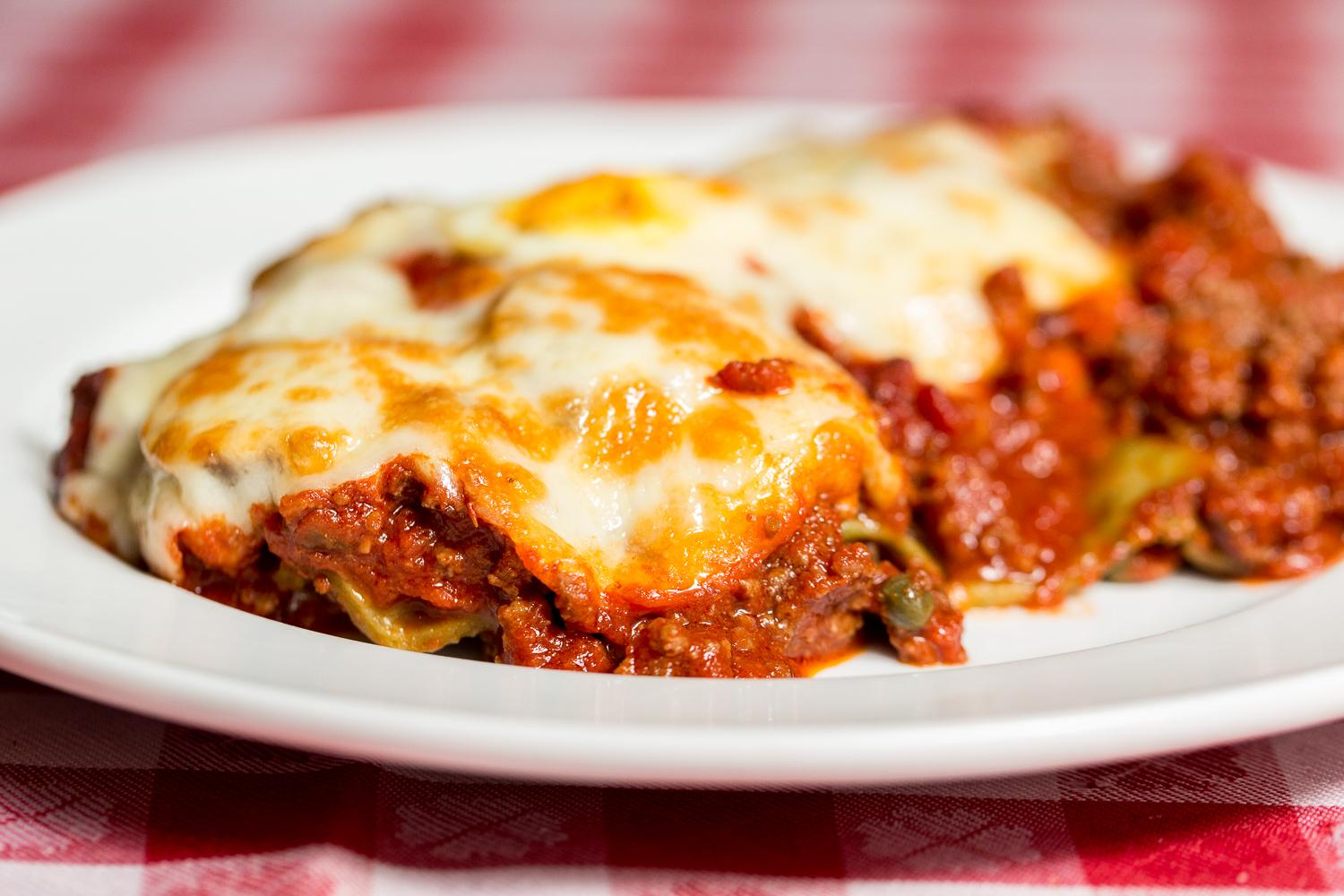Green Lasagna D'Amelia (spinach lasagna baked with meat sauce, mozzarella, & ricotta cheese; topped with Italian Sausage) / Image: Daniel Smyth Photography
