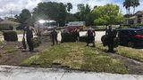 First responders help save Florida man's life then return to help finish his yard