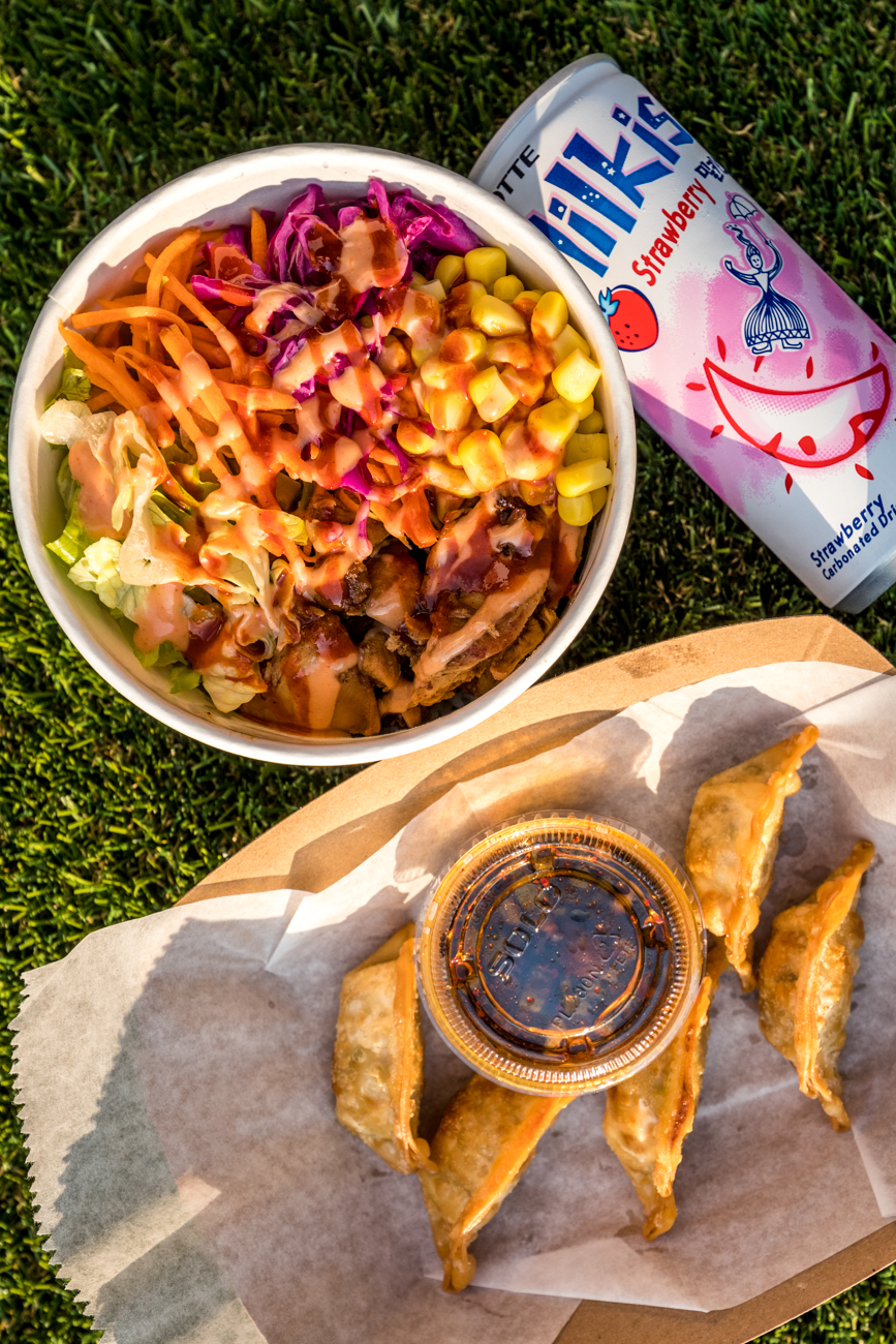 Pork Bulgogi (spicy marinated pork with lettuce, cabbage, carro,t and sweet corn over rice) and the beef dumplings from Mr. Bulgogi paired with a strawberry Milkis /Image: Catherine Viox{ }// Published: 10.15.20